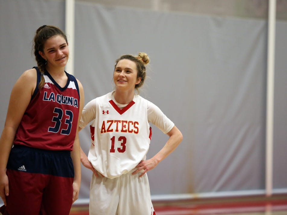 La Quinta's Emma Svoboda, left, and Palm Desert's Alexis Legan share a moment during the fourth quarter of the game in Palm Desert on Friday, January 11, 2019. Palm Desert won.