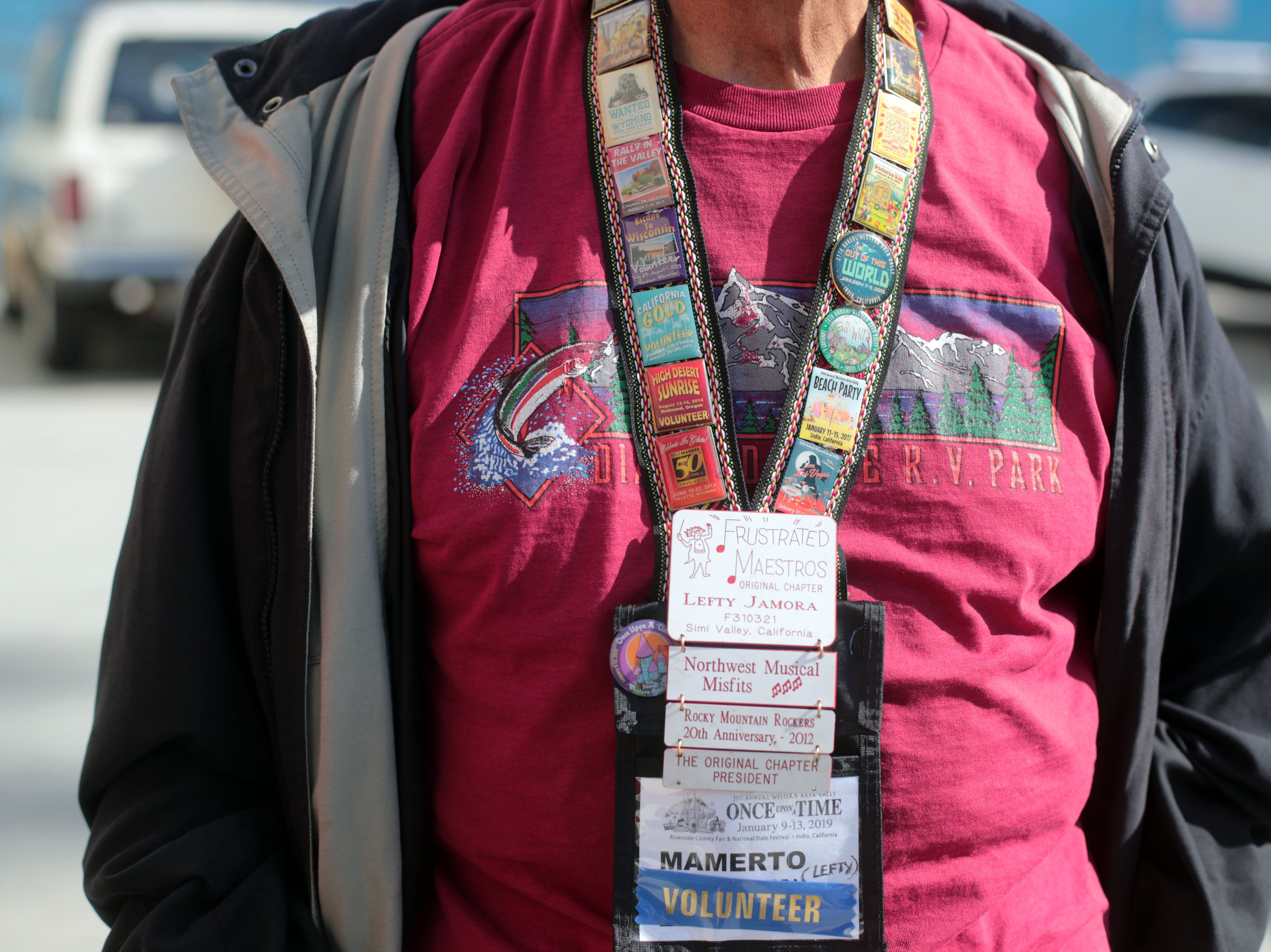 Lefty Jamora's ID badges shows the RV conventions he has attended at the Riverside County Fairground in Indio on Saturday, January 12, 2019, during the FMCA annual motorhome convention.