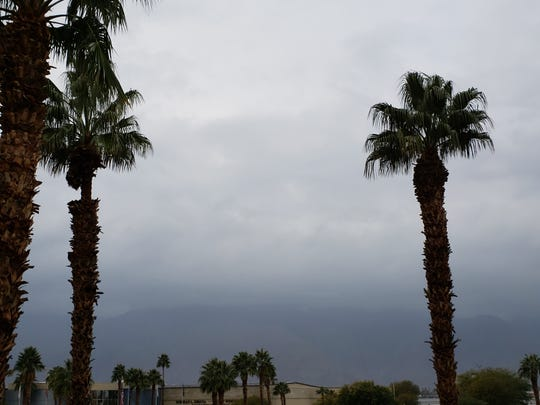 Mount San Jacinto is shrouded in clouds on Saturday morning as rainfall swept through the Coachella Valley.