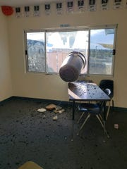 A trash can hangs out a classroom window at Morongo Unified School District's PLUS Program, where teachers union leaders say teachers aren't equipped to handle their students' behaviors.