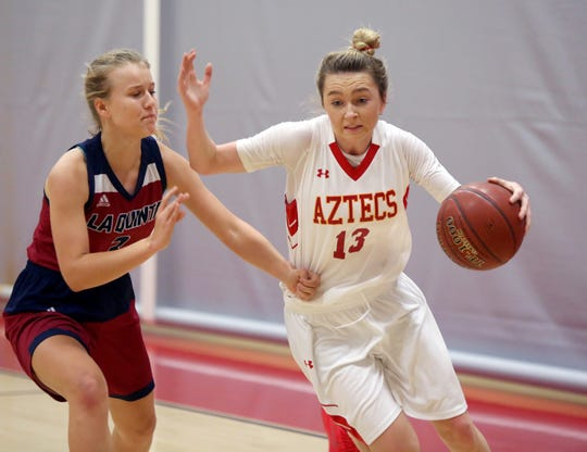 Palm Desert's Alexis Legan tries to find a lane against La Quinta's Francine Ansley on Friday night.