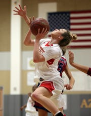 Palm Desert's Alexis Legan, seen here scoring against La Quinta on Friday, scored 50 points in a win over Rancho Mirage on Wednesday.