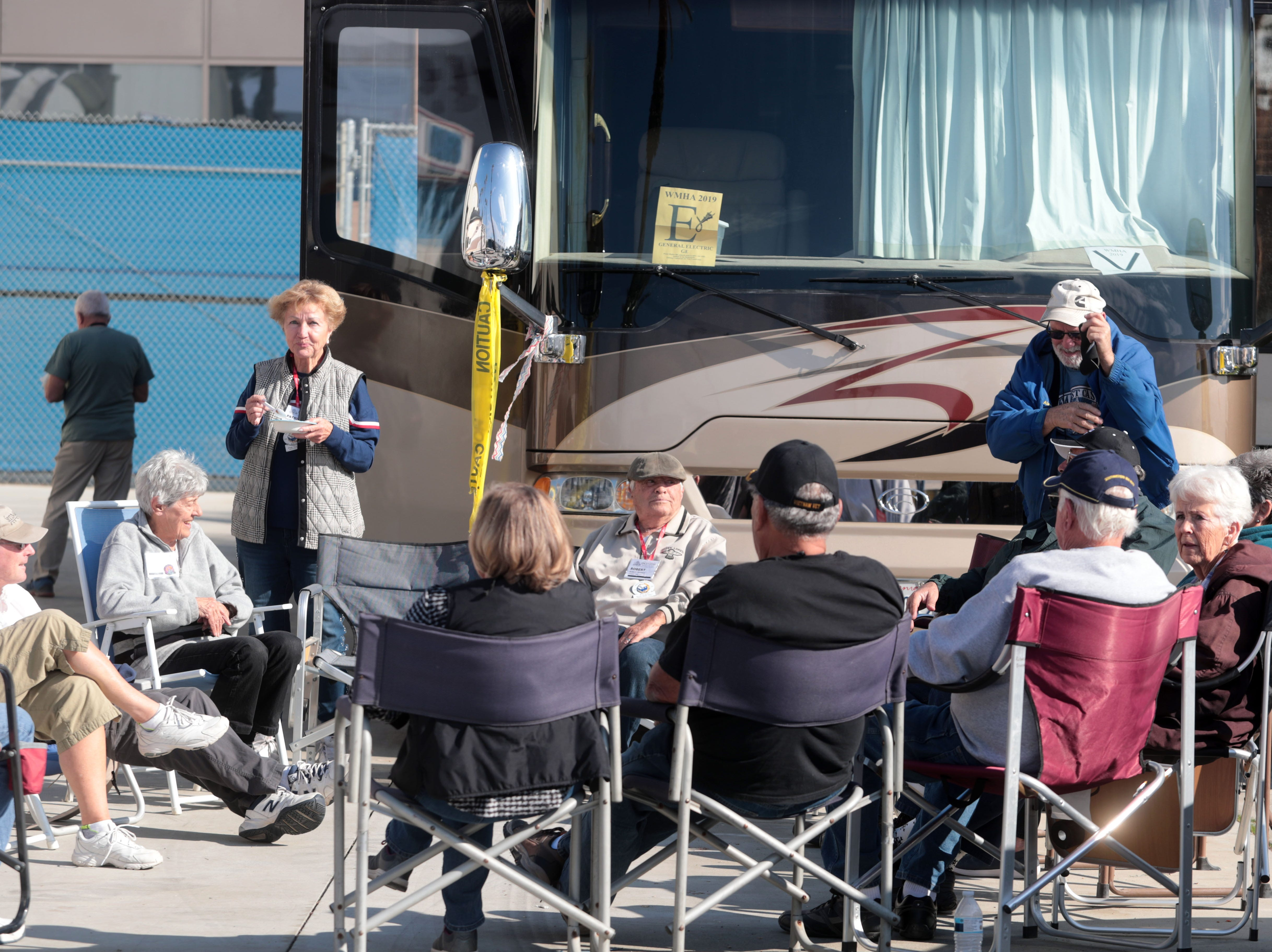RV owners in a circle at the Riverside County Fairground in Indio on Saturday, January 12, 2019, during the FMCA annual motorhome convention.