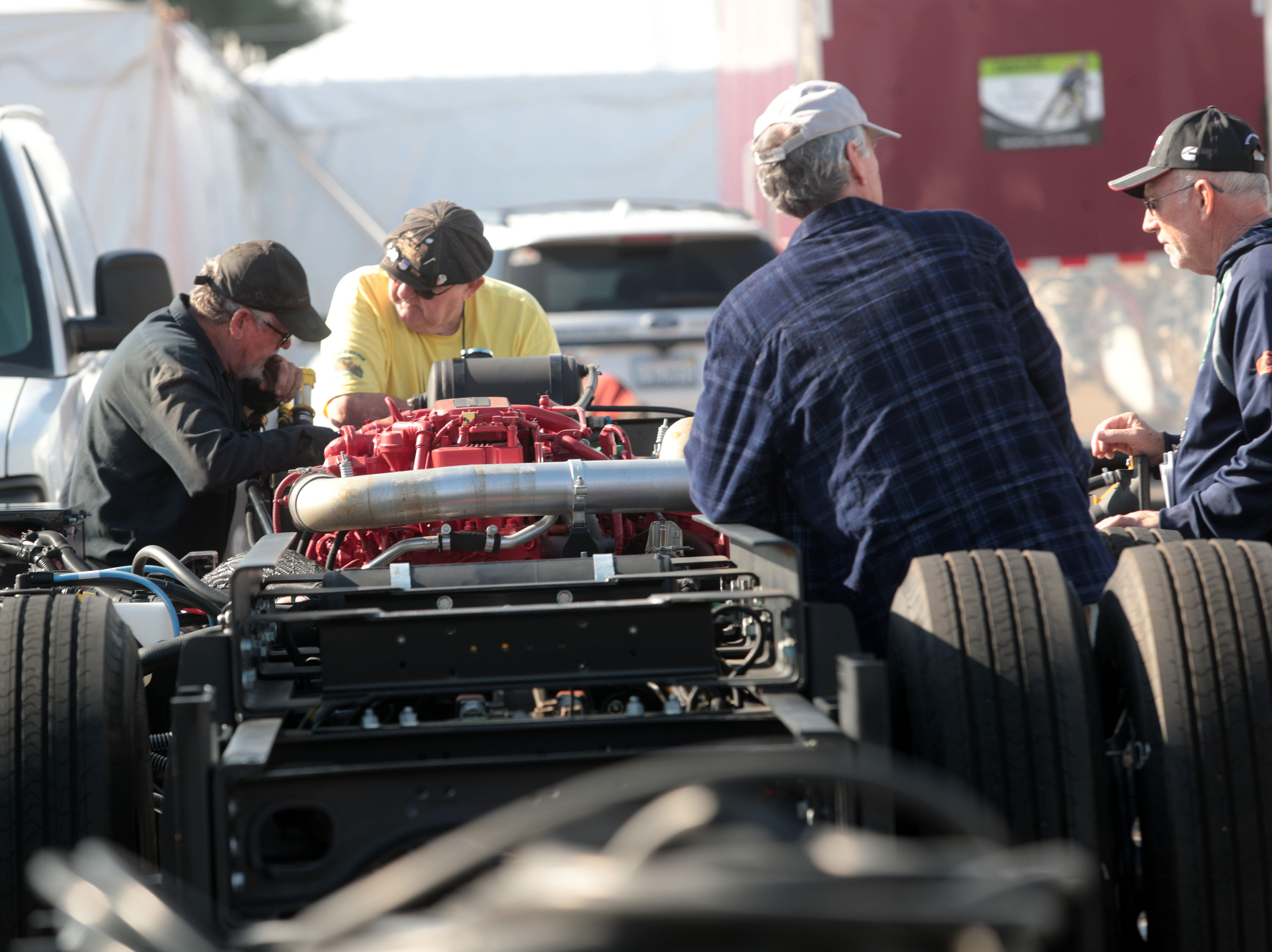 RVs owners talk engines at Riverside County Fairgrounds in Indio on Saturday, January 12, 2019, during the FMCA annual motorhome convention.