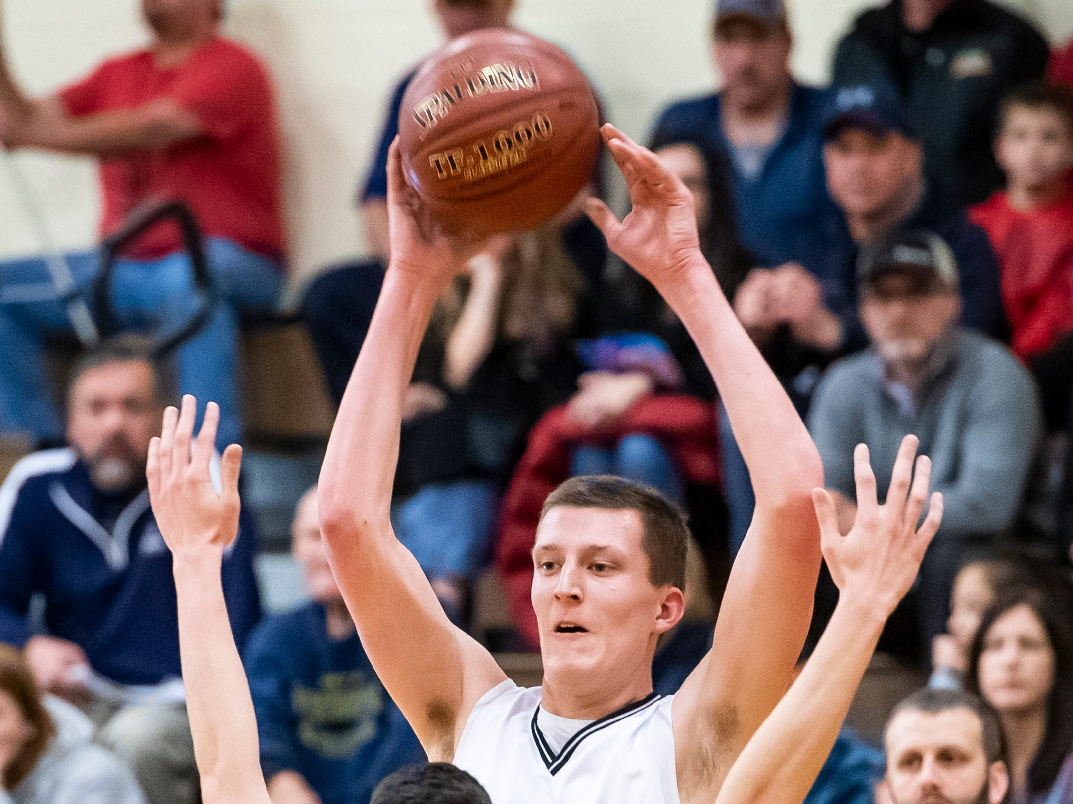 6-foot-8-inch Biglerville center Drew Riley holds the ball up during play against Littlestown on Friday, January 11, 2019. The Canners fell 65-38.