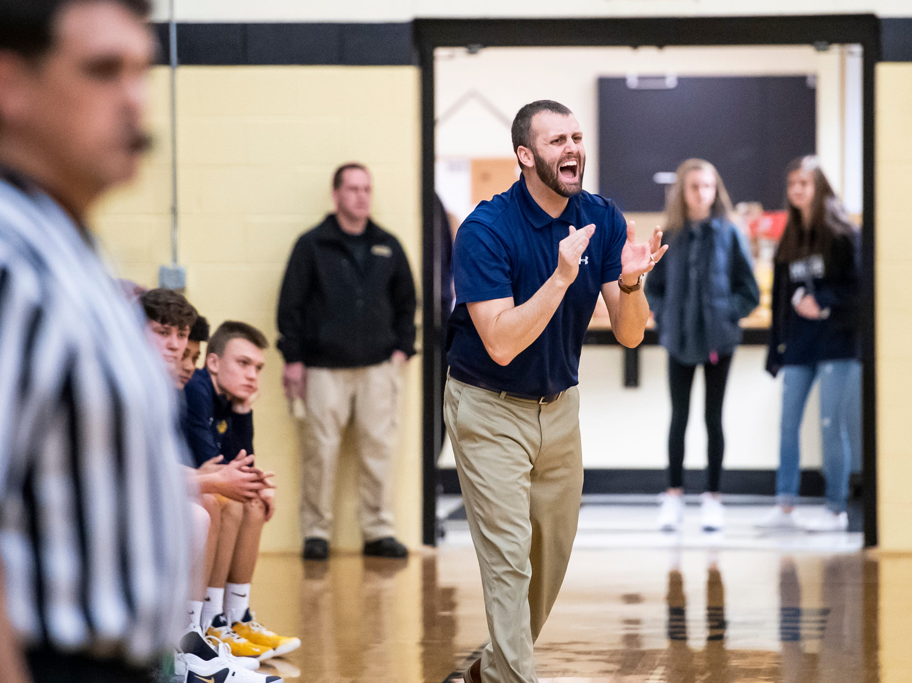 Littlestown head coach Jonathan Forster reacts after the Bolts score during play against Biglerville on Friday, January 11, 2019. The Bolts won 65-38.