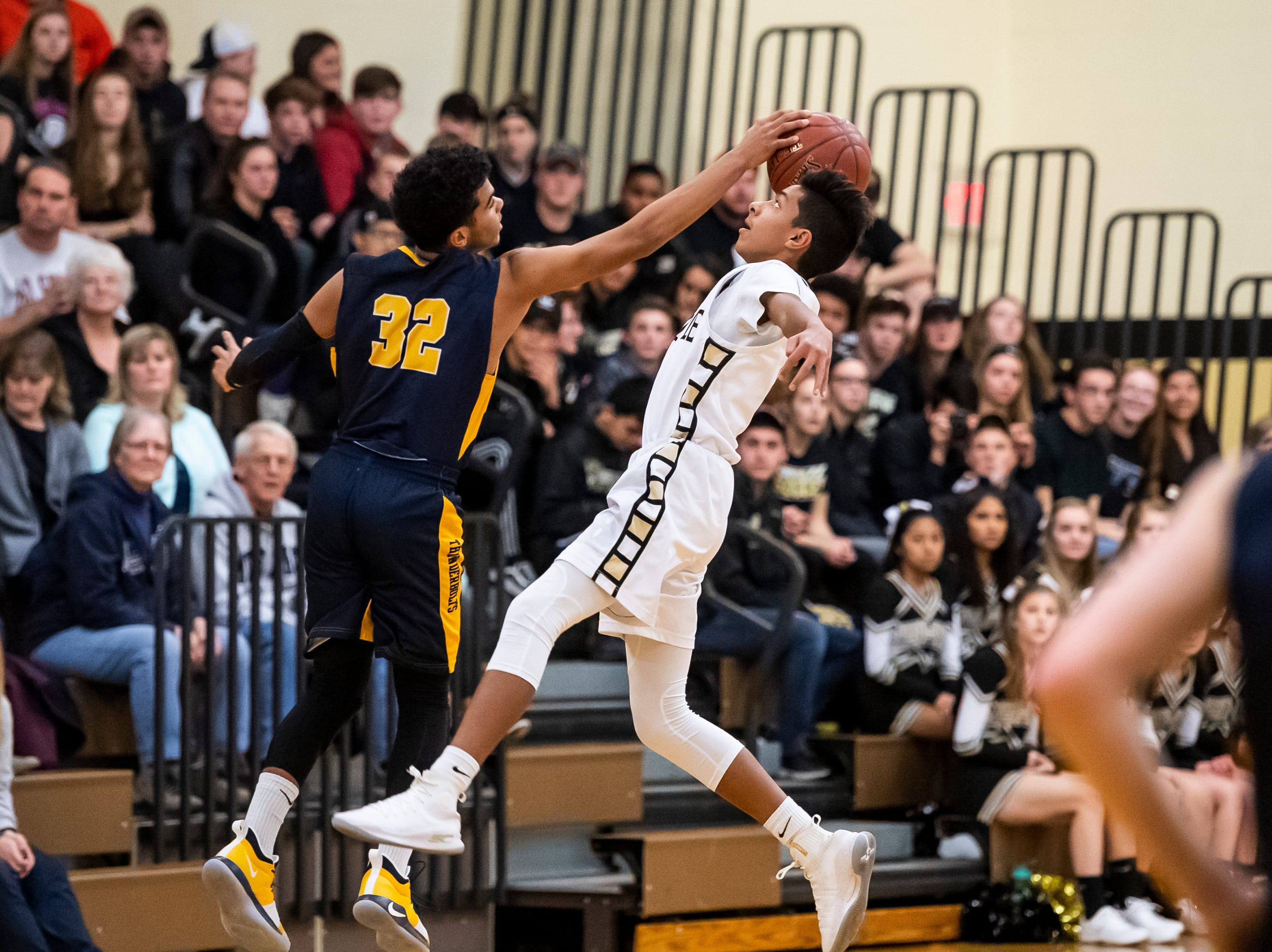 Littlestown's Jayden Weishaar steals the ball from Biglerville's Jorge Cervantes on Friday, January 11, 2019. The Bolts won 65-38.
