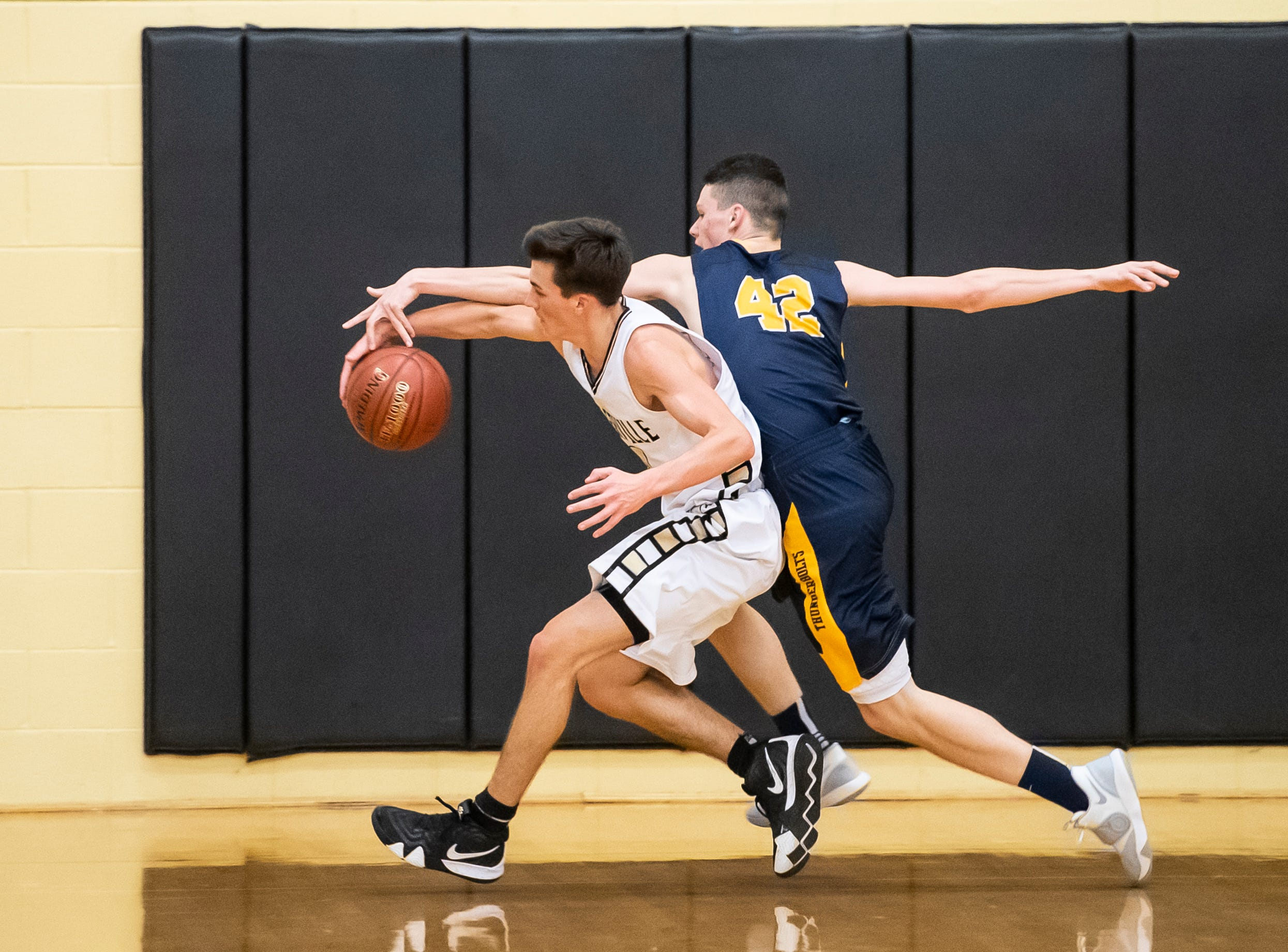 Biglerville's Colby Martin keeps the ball away from Littlestown's Brayden Staub (42) during play on Friday, January 11, 2019. The Canners fell 65-38.