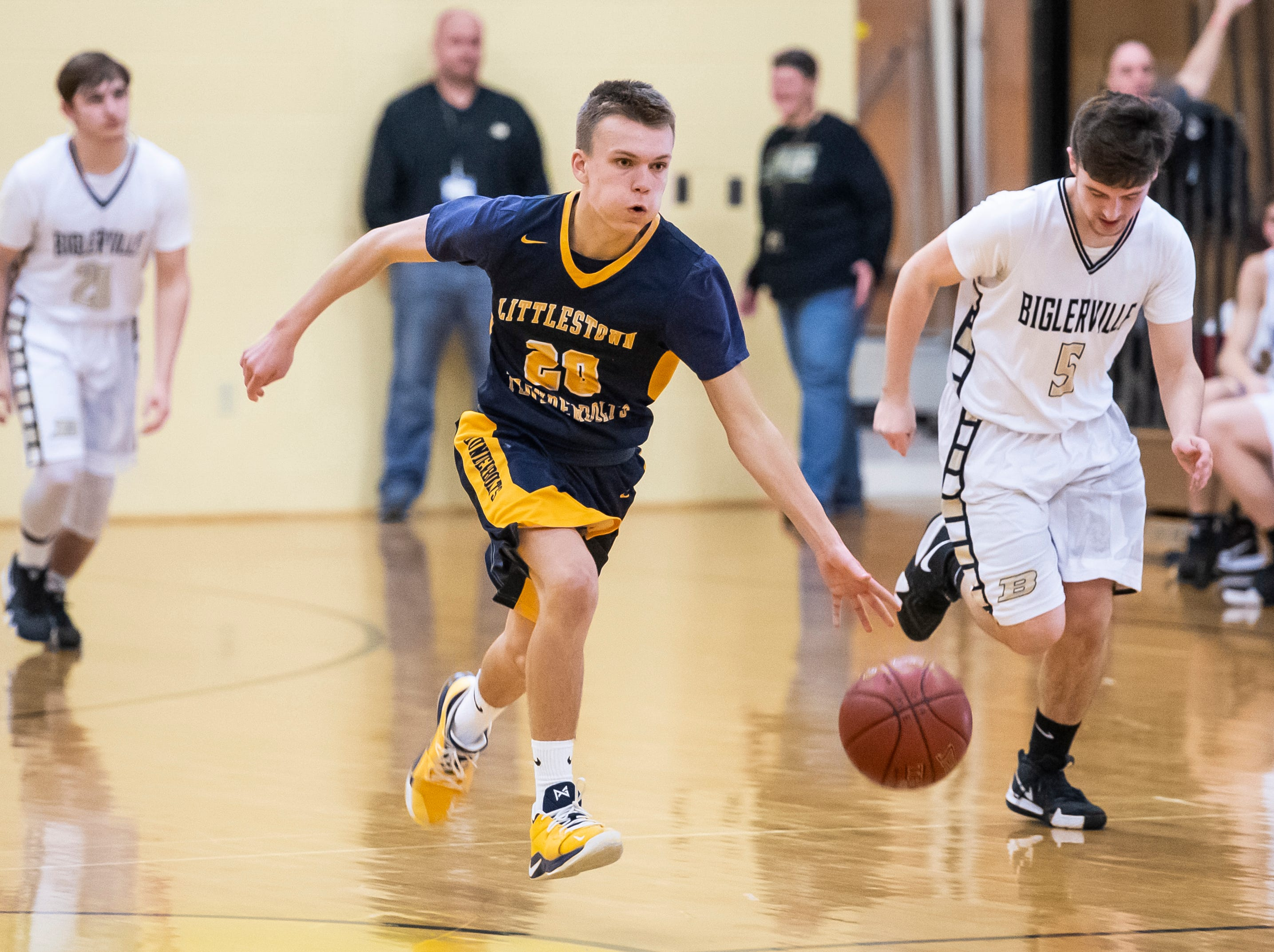 Littlestown's Braden Unger dribbles down the court during play against Biglerville on Friday, January 11, 2019. The Bolts won 65-38.