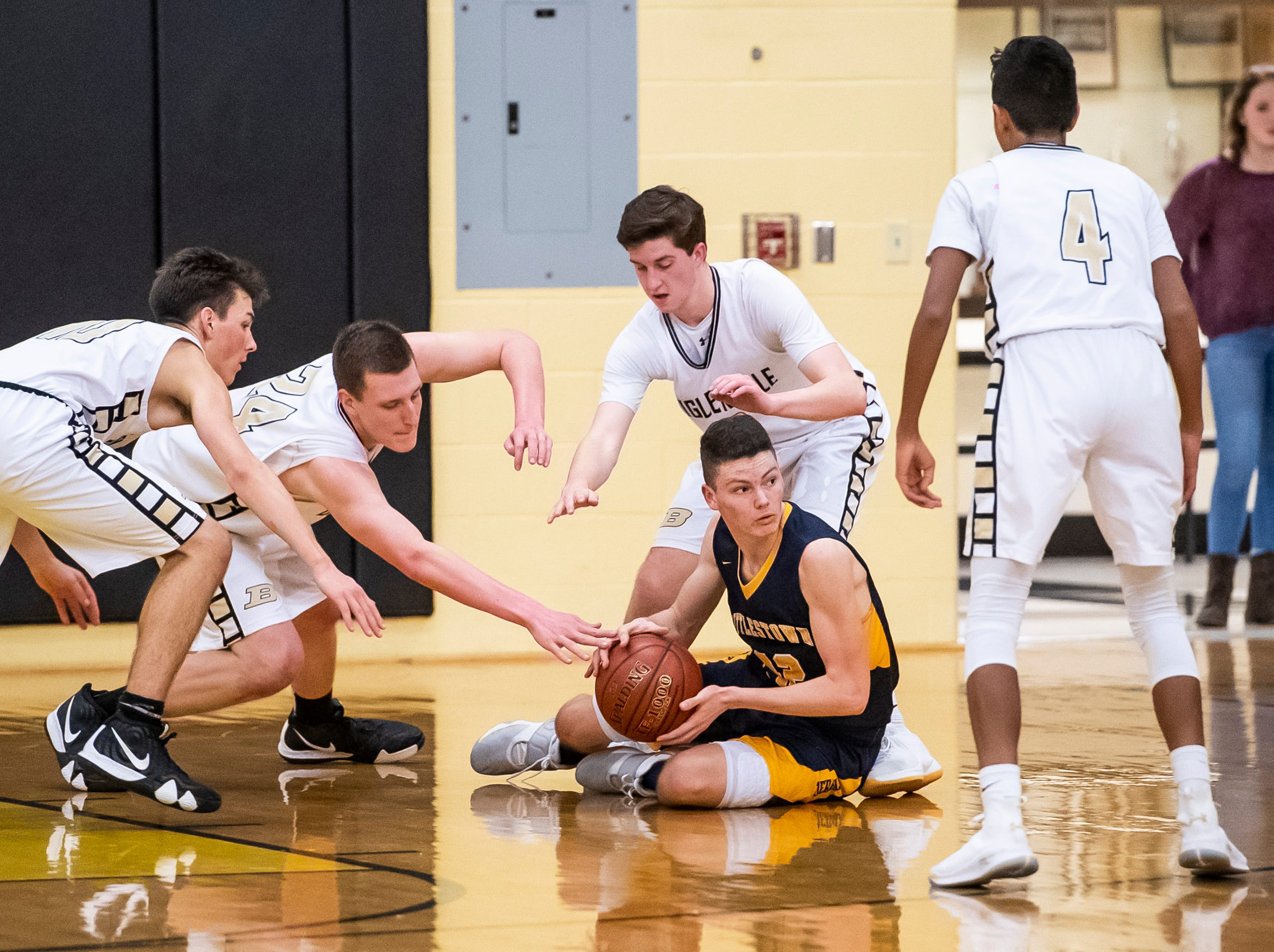 Littlestown's Brayden Staub holds onto the ball during play against Biglerville on Friday, January 11, 2019. The Bolts won 65-38.