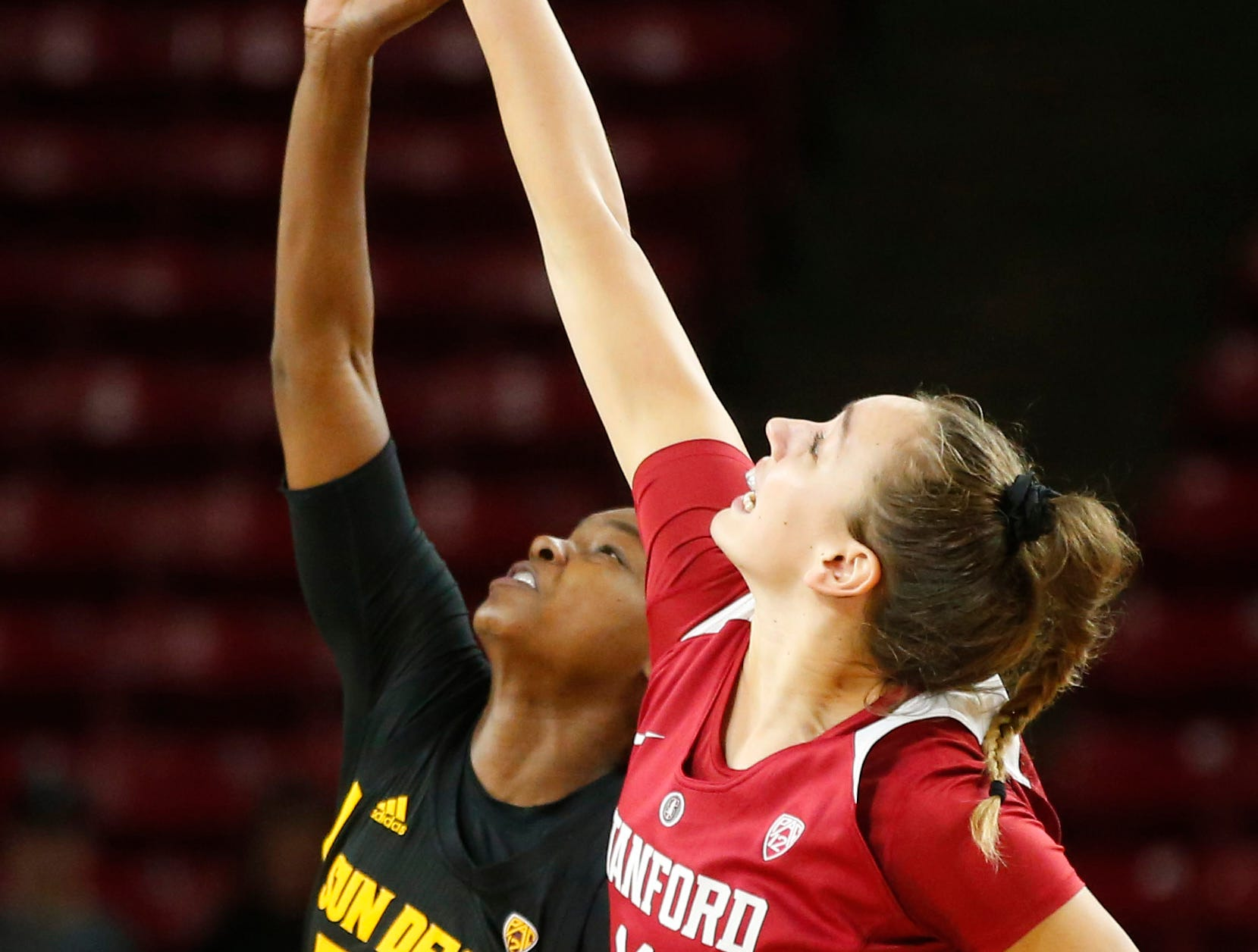 Arizona State University Charnea Johnson-Chapman (33) tips off the ball against Stanford University Alanna Smith (11) during a women's basketball game at Well Fargo Arena in Tempe on January 11.