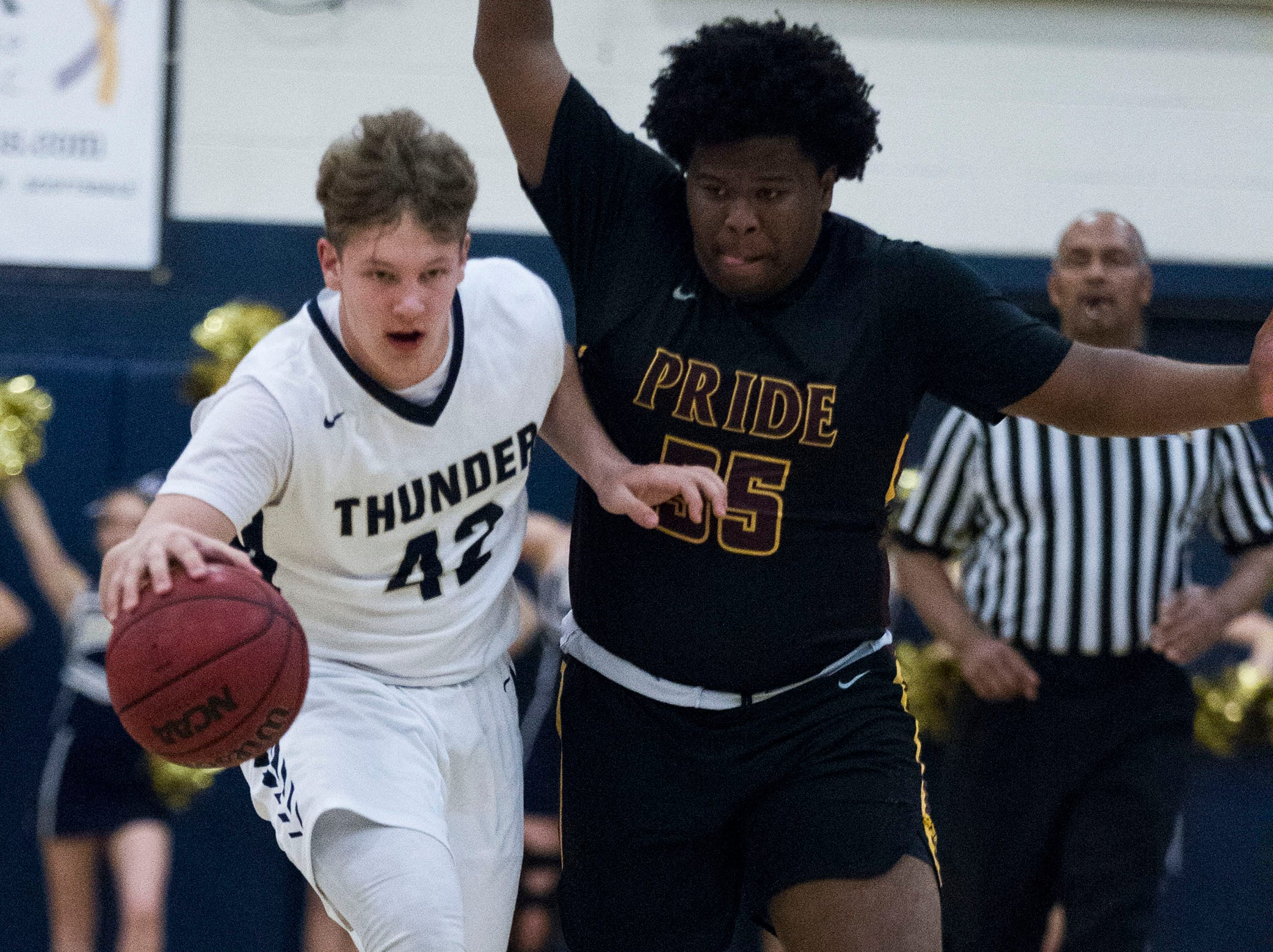 Desert Vista's Hayden Engle (42) gets caught up with Mountain Pointe's Kalil Simmons (35) during in the first half of their game at Desert Vista High School in Phoenix, Friday, Jan.11, 2019.