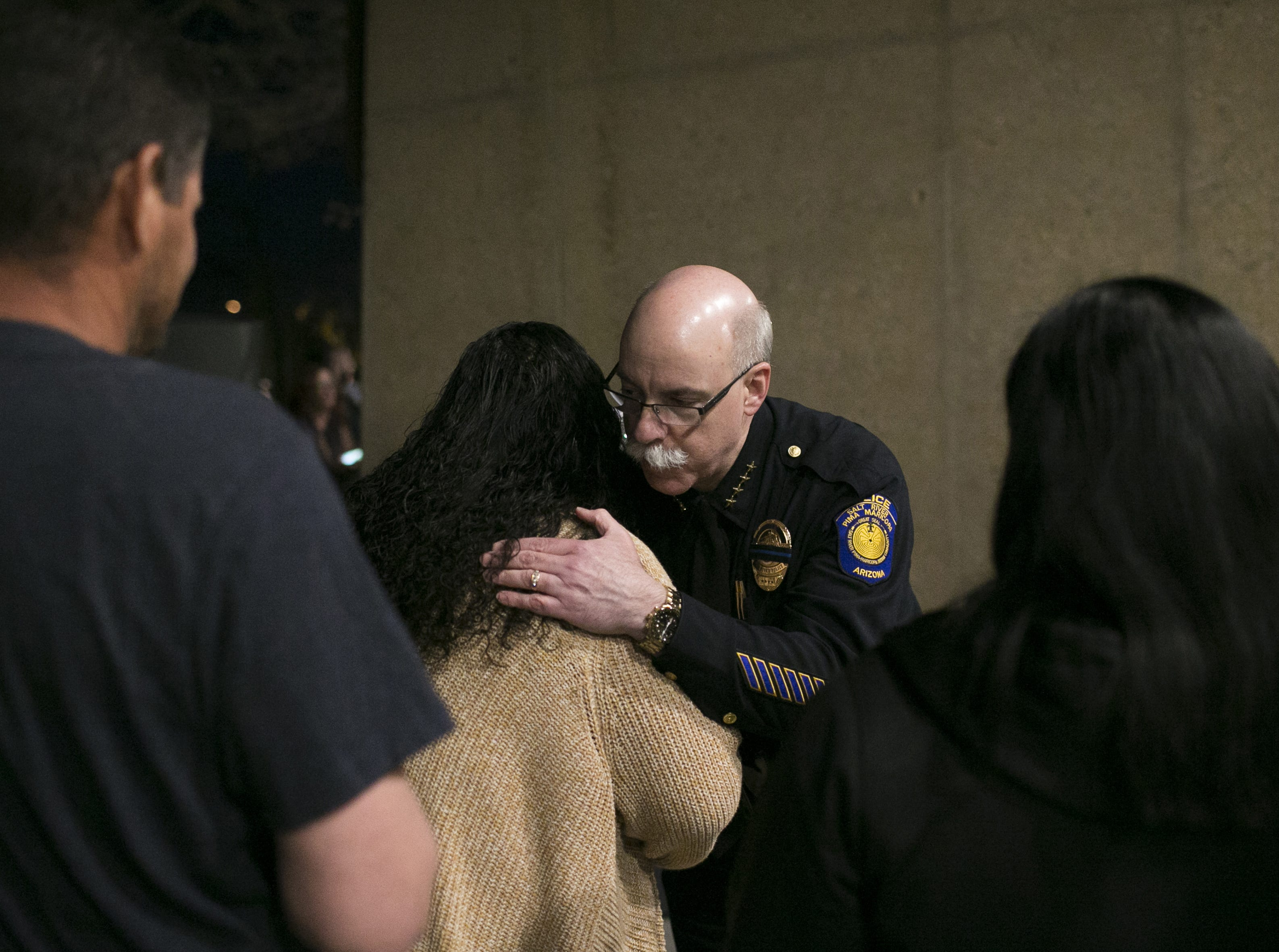 Salt River Police Chief Karl Auerbach comforts people attending a vigil to remember Salt River tribal police Officer Clayton Townsend at Two Waters Courtyard in Scottsdale on Jan. 11, 2019.