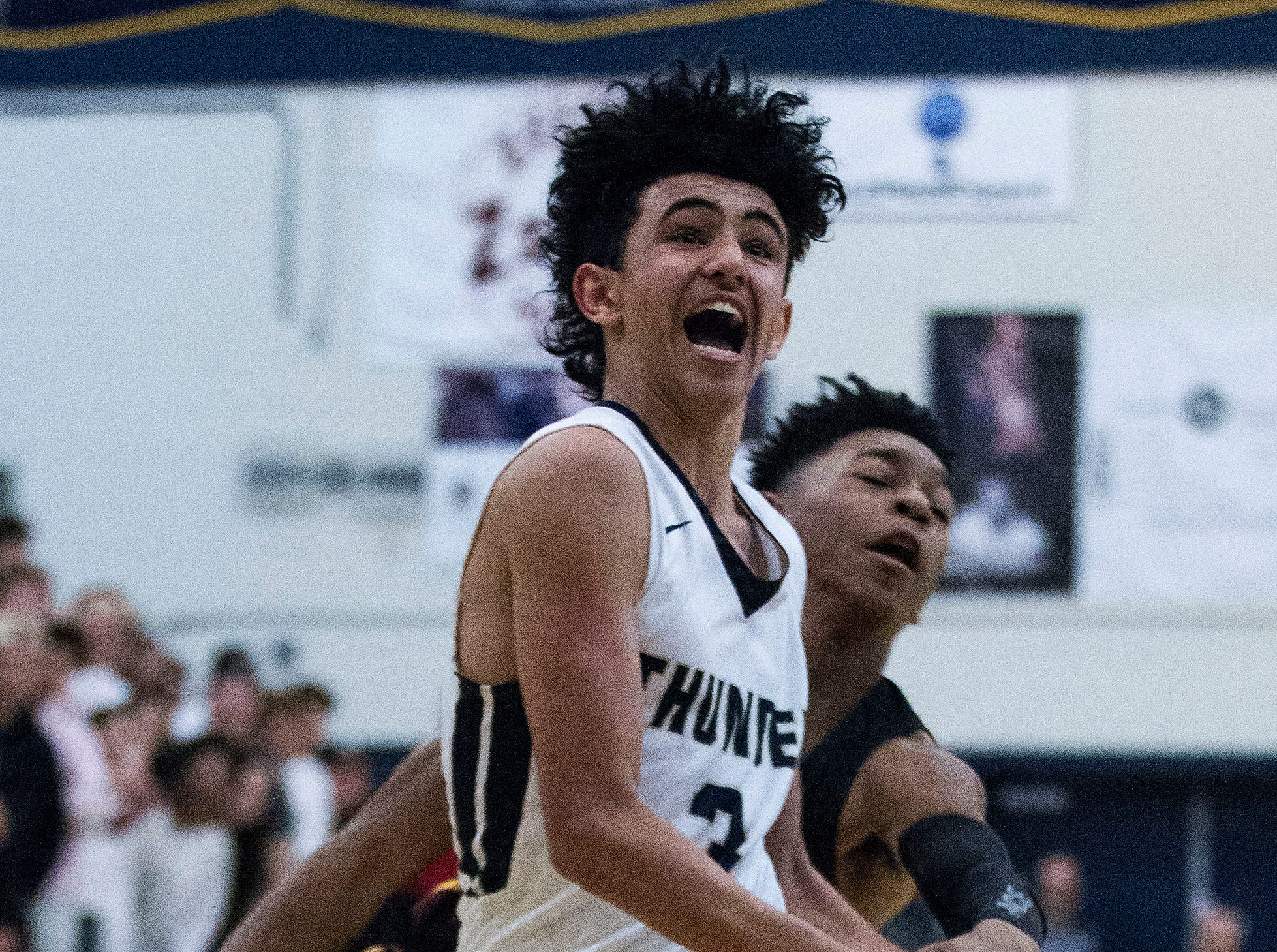 Desert Vista's Marcus Wady (3) get fouled by Mountain Pointe's Jason Kimbrough (0) during in the first half of their game at Desert Vista High School in Phoenix, Friday, Jan.11, 2019.