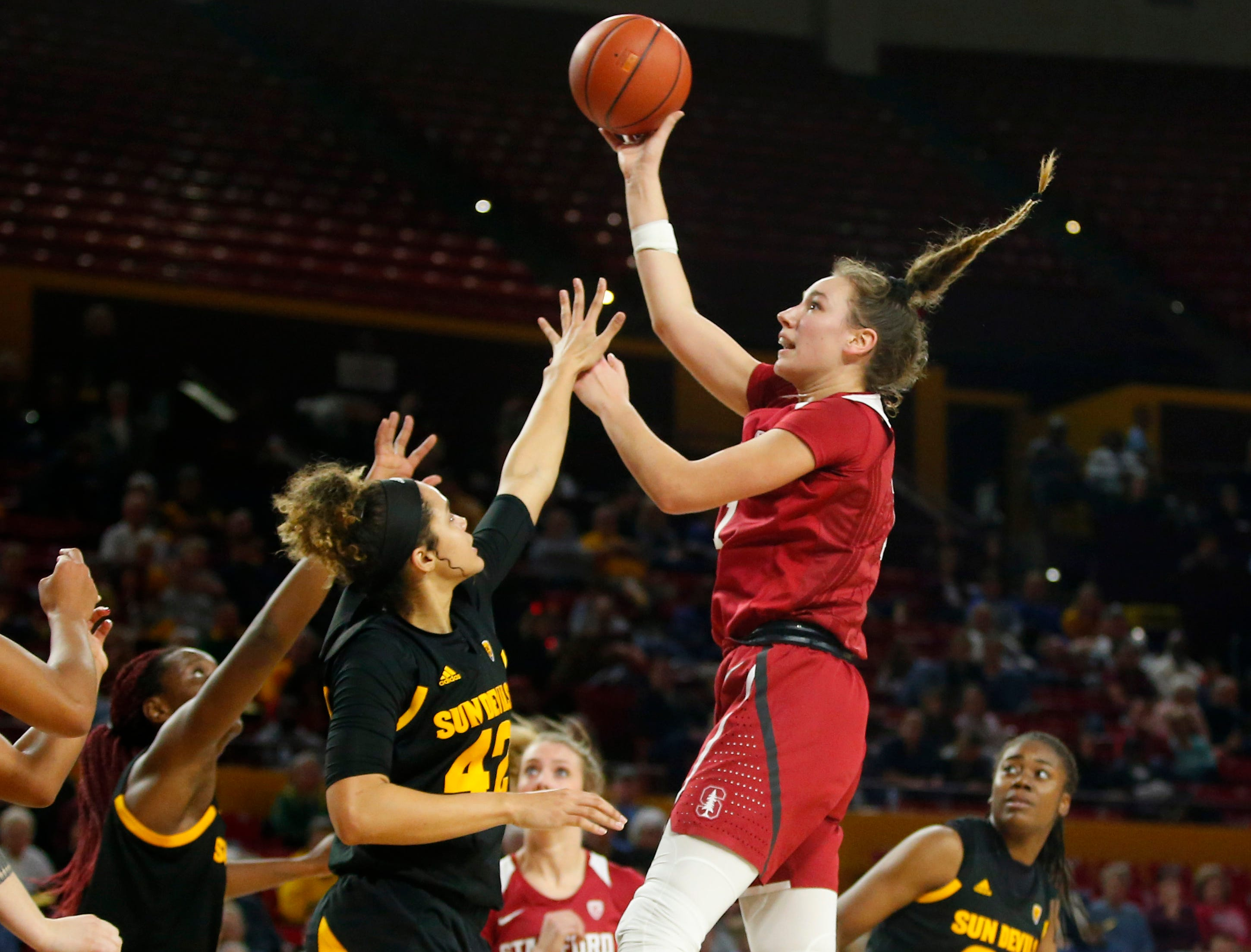 Stanford University Alanna Smith (11) takes a shot while being guarded by Arizona State University Kianna Ibis (42) during a women's basketball game at Well Fargo Arena in Tempe on January 11.