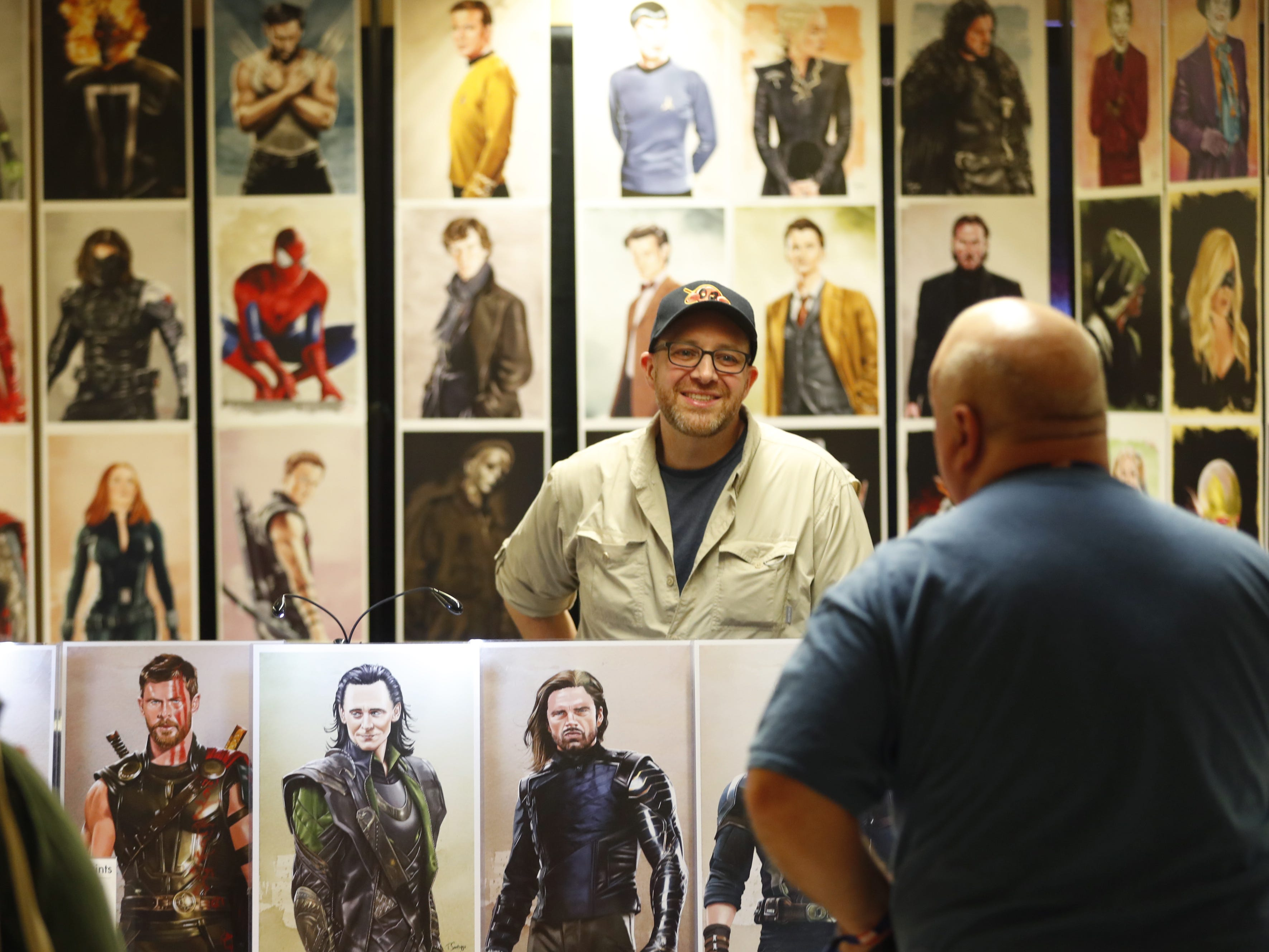 Tony Santiago sells his portraits of famous characters at his booth during the opening day of Ace Comic Con 2019 at Gila River Arena in Glendale, Ariz. on Jan. 11, 2019.
