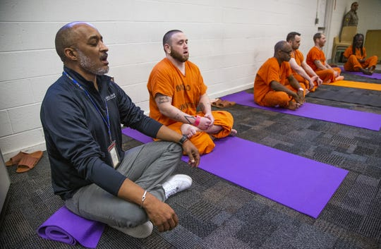 Dr. Julian Wyatt (left), the director of the Prison Yoga Project Phoenix, conducts a yoga class at the Maricopa County Towers Jail complex on Jan. 11, 2019.