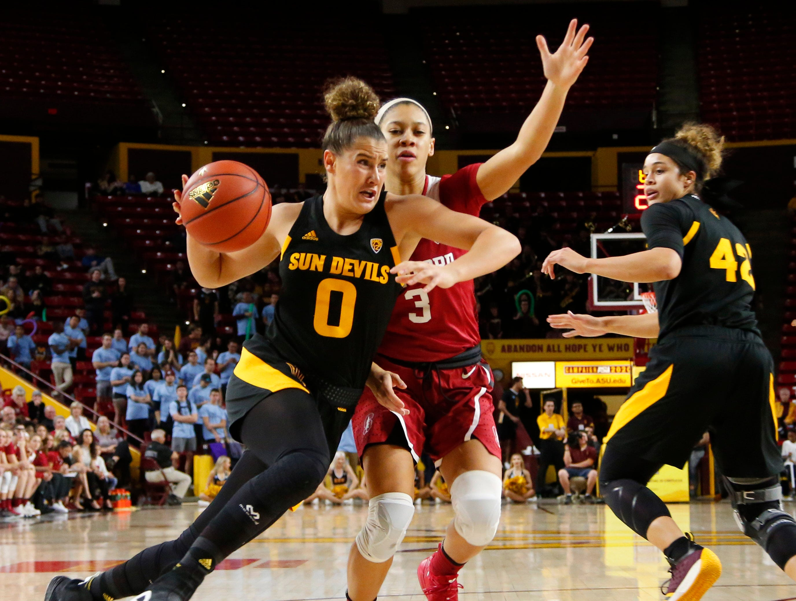 Arizona State University Taya Hanson (0)  dribbles around Stanford University Anna Wilson (3) during a women's basketball game at Well Fargo Arena in Tempe on January 11.