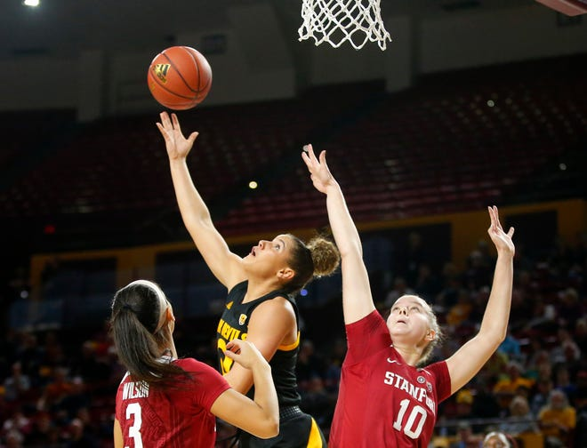Arizona State University Taya Hanson (0)  takes a shot while being guarded by Stanford University Anna Wilson (3) and Alyssa Jerome (10) during a women's basketball game at Well Fargo Arena in Tempe on January 11.
