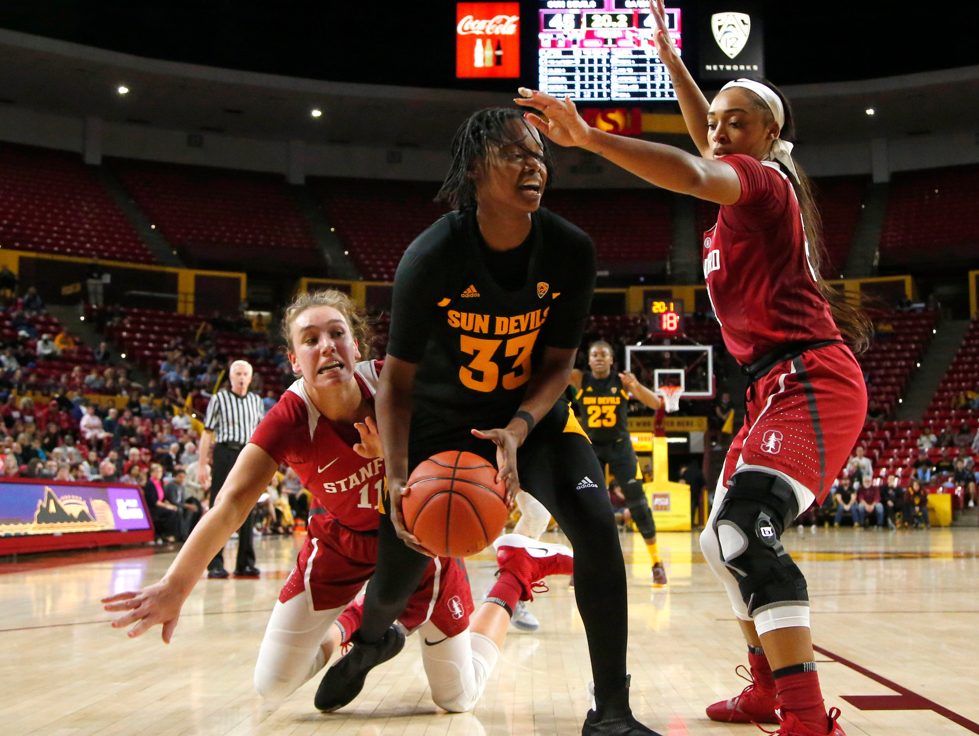Stanford University Alanna Smith (11) and Dijonai Carrington (21), right, guard Arizona State University Charnea Johnson-Chapman (33) during a women's basketball game at Well Fargo Arena in Tempe on January 11.
