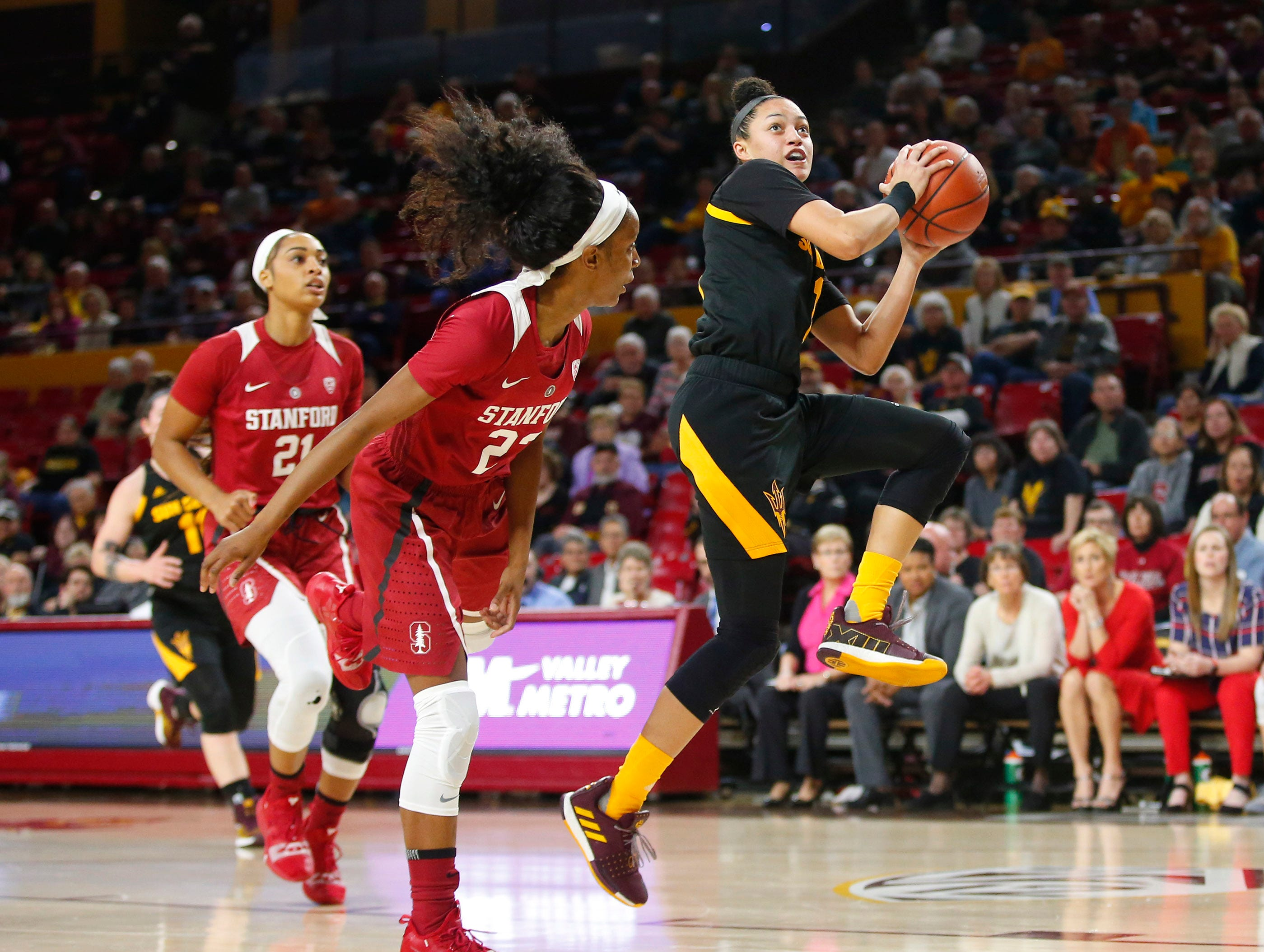 Arizona State University Reili Richardson (1)  looks to shoot while being guarded by Stanford University Kiana Williams (23)during a women's basketball game at Well Fargo Ar ena in Tempe on January 11.