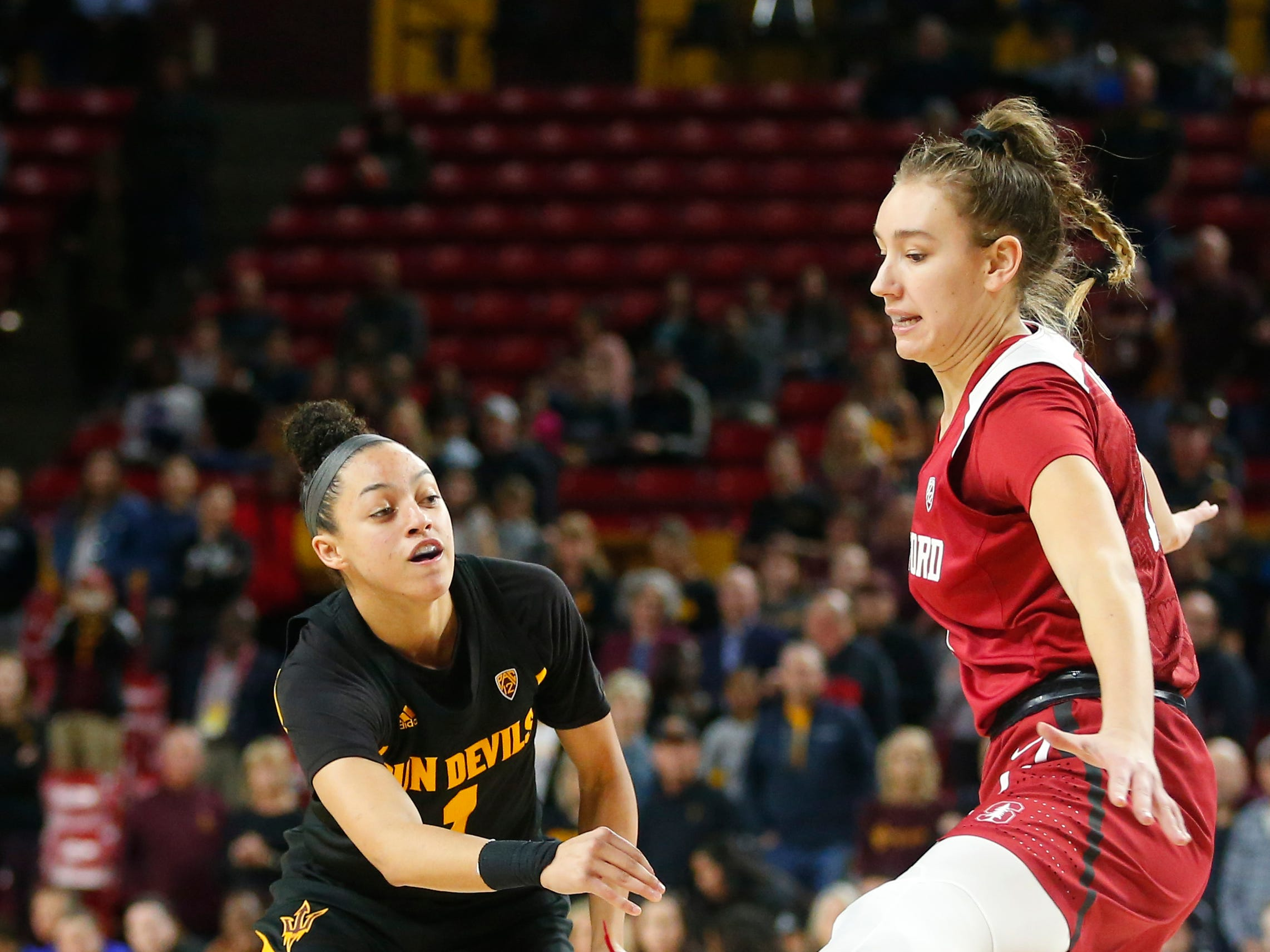 Arizona State University Reili Richardson (1)  passes the ball around Stanford University Alanna Smith (11) during a women's basketball game at Well Fargo Arena in Tempe on January 11.