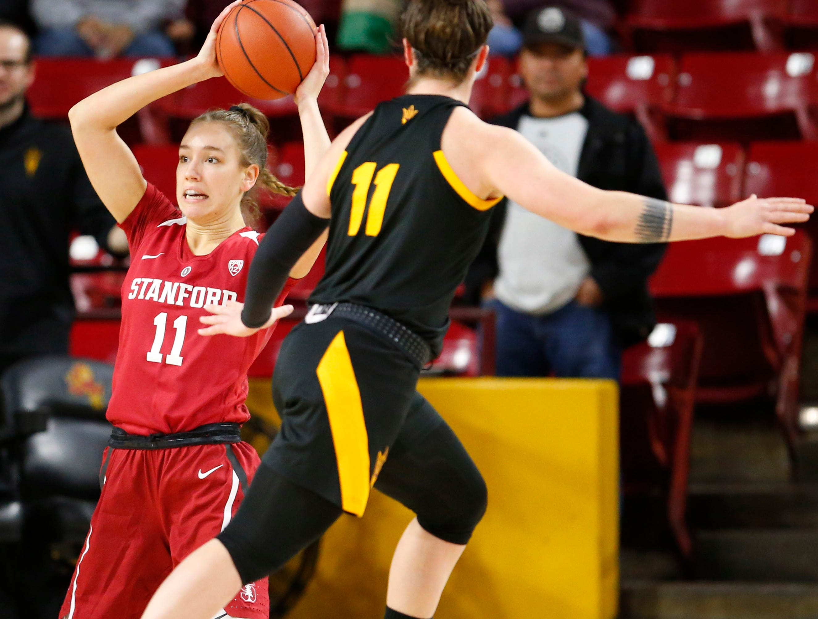 Stanford University Alanna Smith (11) attempts to save the ball while being guarded by Arizona State University Robbi Ryan (11) during a women's basketball game at Well Fargo Arena in Tempe on January 11.
