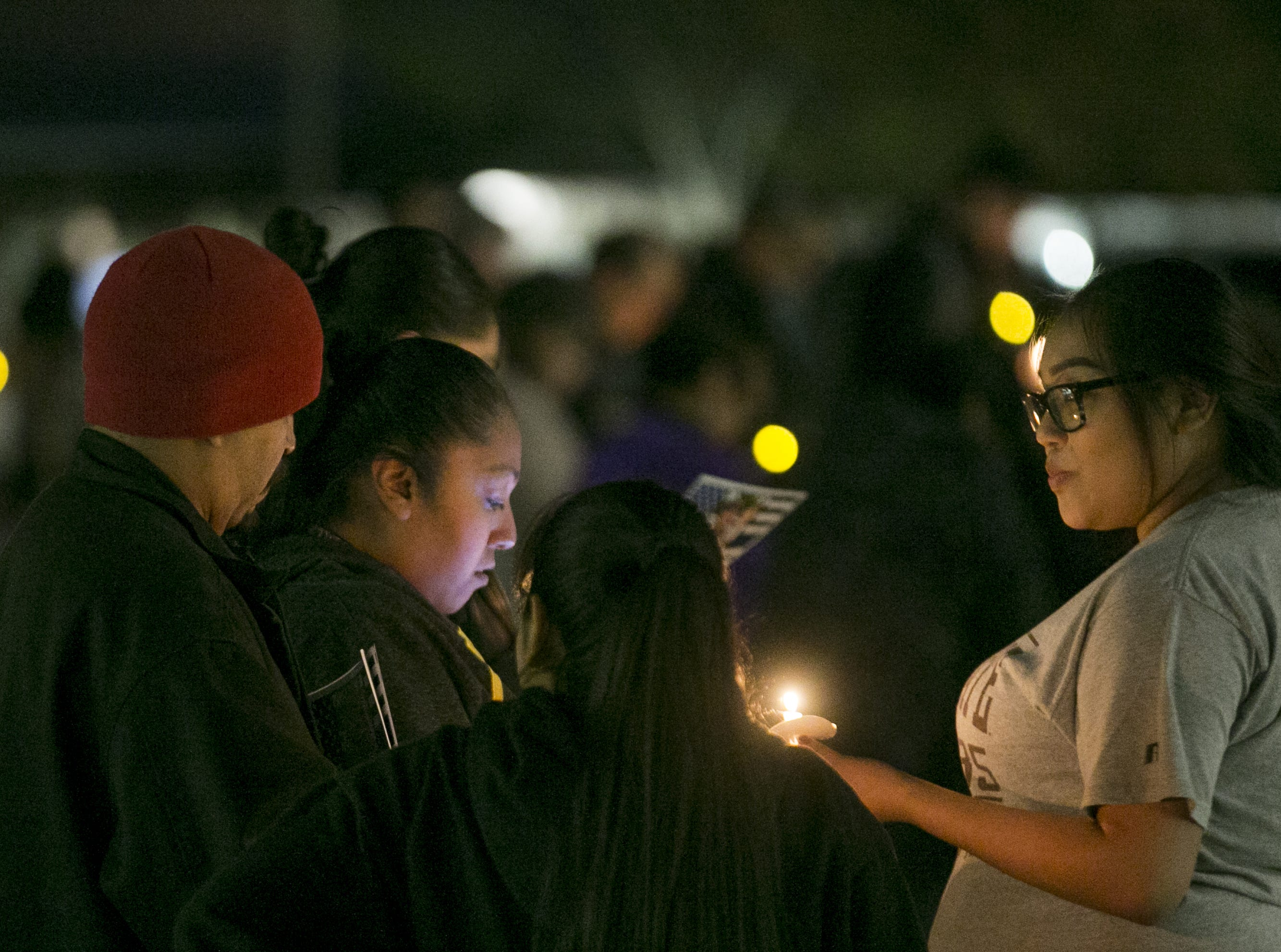 Hundreds gather to remember Salt River tribal police Officer Clayton Townsend at a vigil at Two Waters Courtyard in Scottsdale on Jan. 11, 2019.