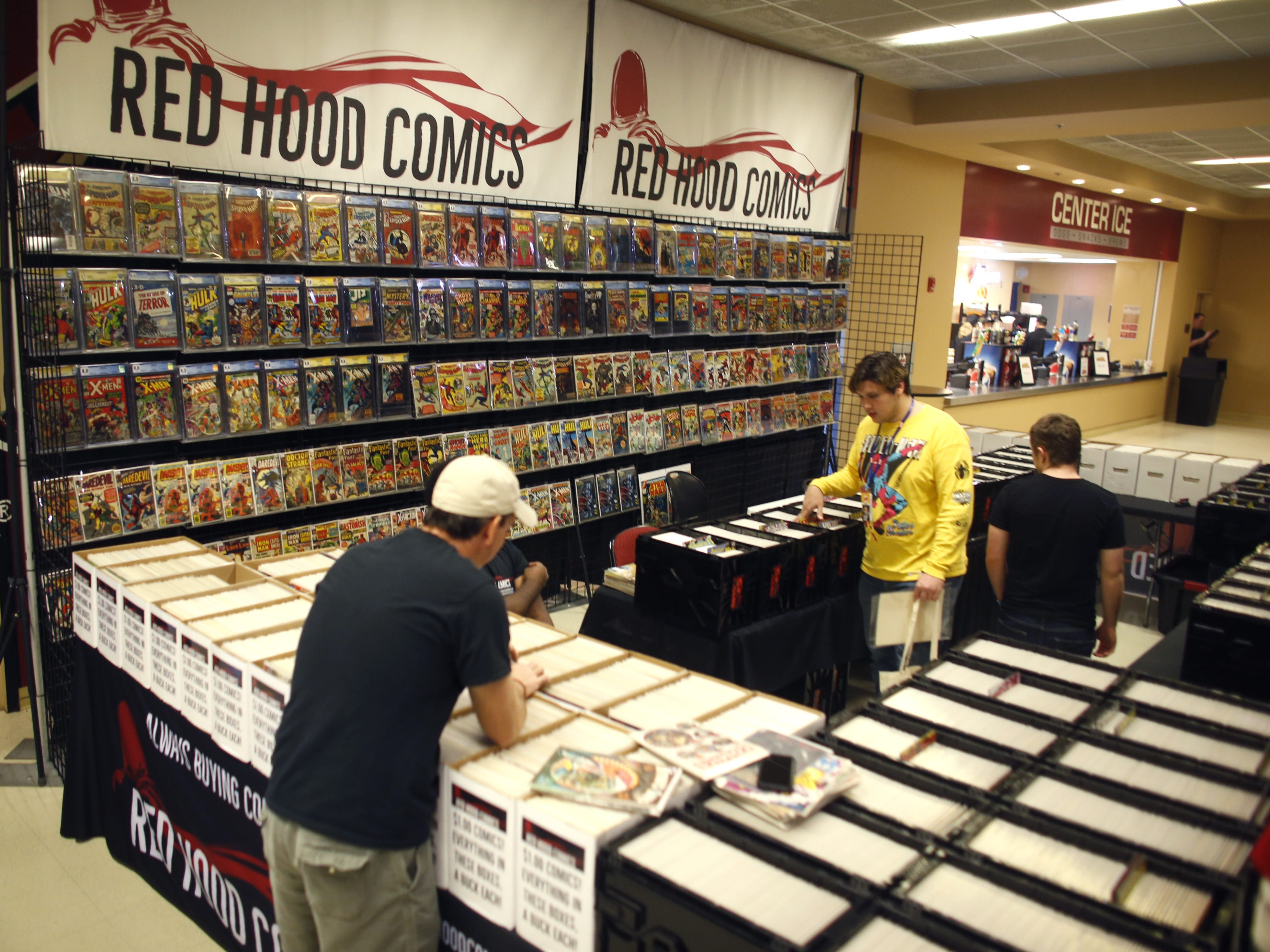 Customers browse the Red Hood Comics booth on opening day of Ace Comic Con 2019 at Gila River Arena in Glendale, Ariz. on Jan. 11, 2019.