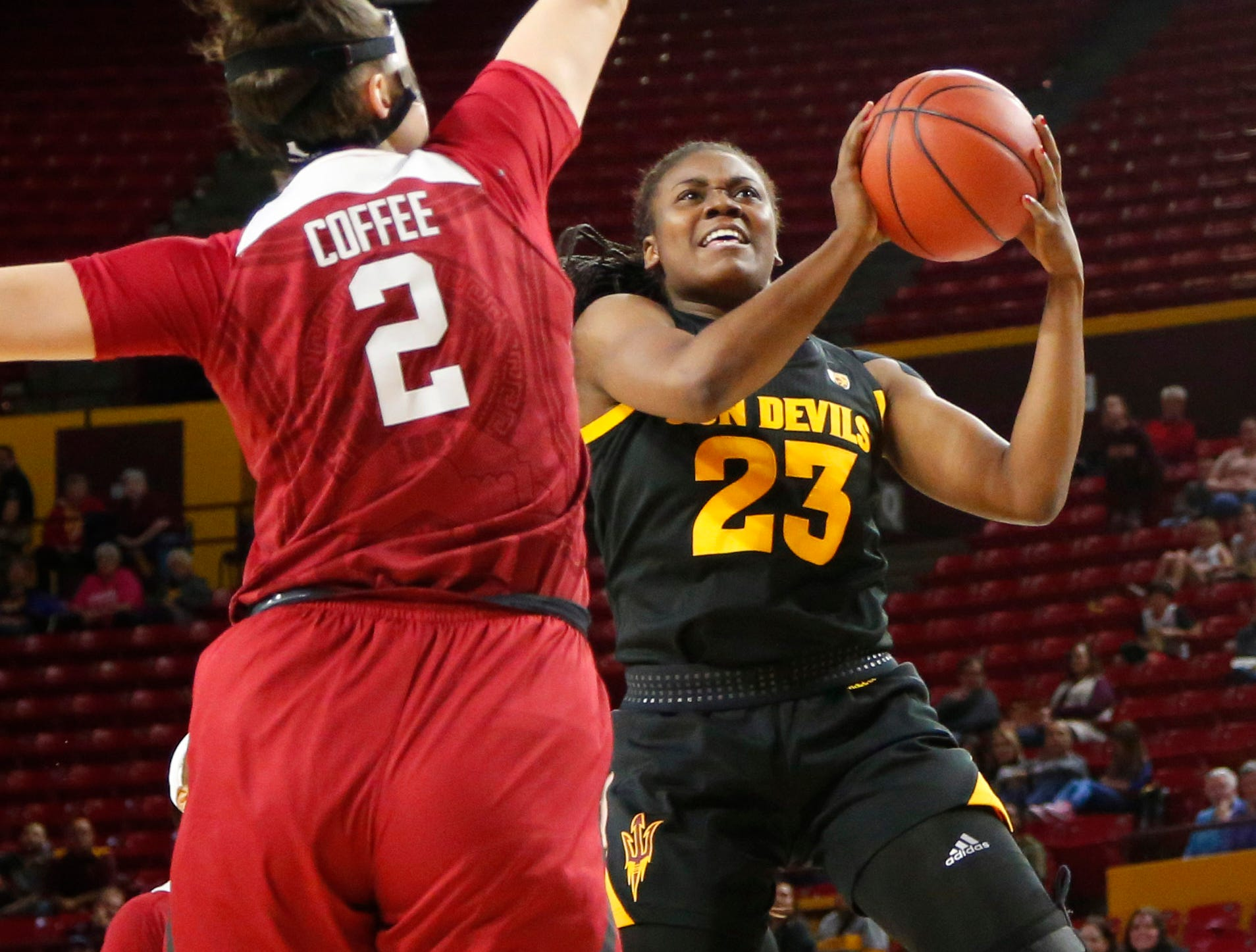 Arizona State University Iris Mbulito (23) goes up for a lay up while being guarded by Stanford University Shannon Coffee (2) during a women's basketball game at Well Fargo Arena in Tempe on January 11.