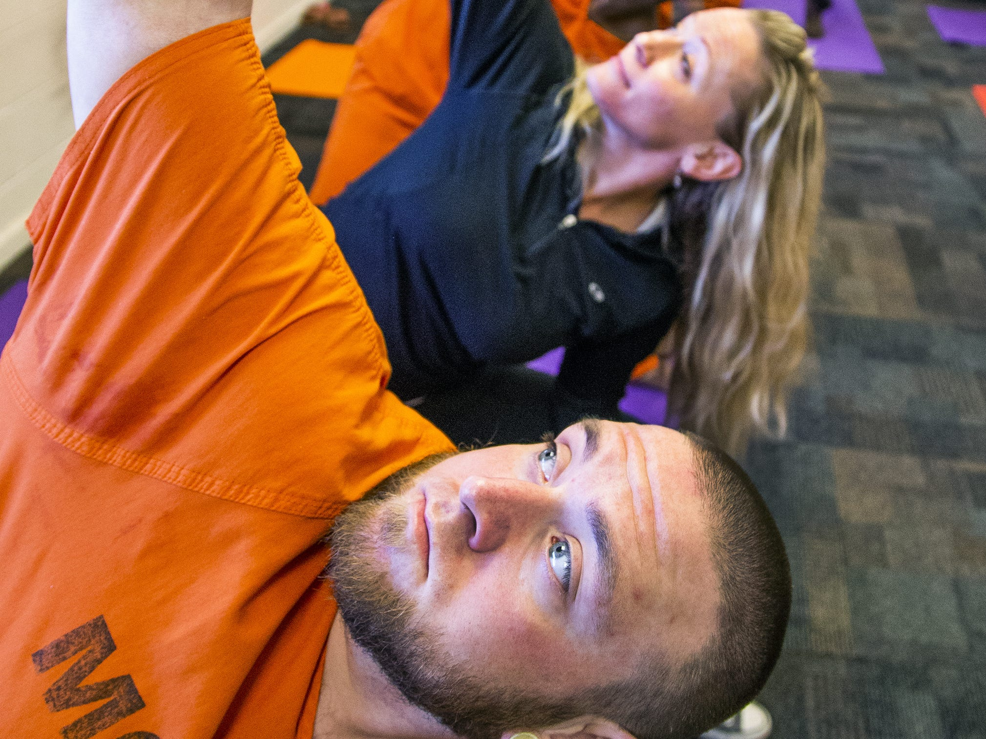 Volunteer Sara Wolf and inmate Preston James (foreground) practice yoga during a class offered by the Prison Yoga Project Phoenix at the Maricopa County Towers Jail complex on Jan. 11, 2019.