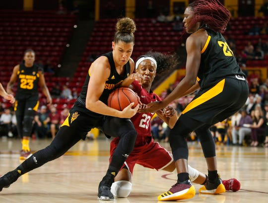Arizona State University Taya Hanson (0), left, and Sophia Elenga (21), right, battle Stanford University Kiana Williams (23) for the ball during a women's basketball game at Well Fargo Arena in Tempe on January 11.