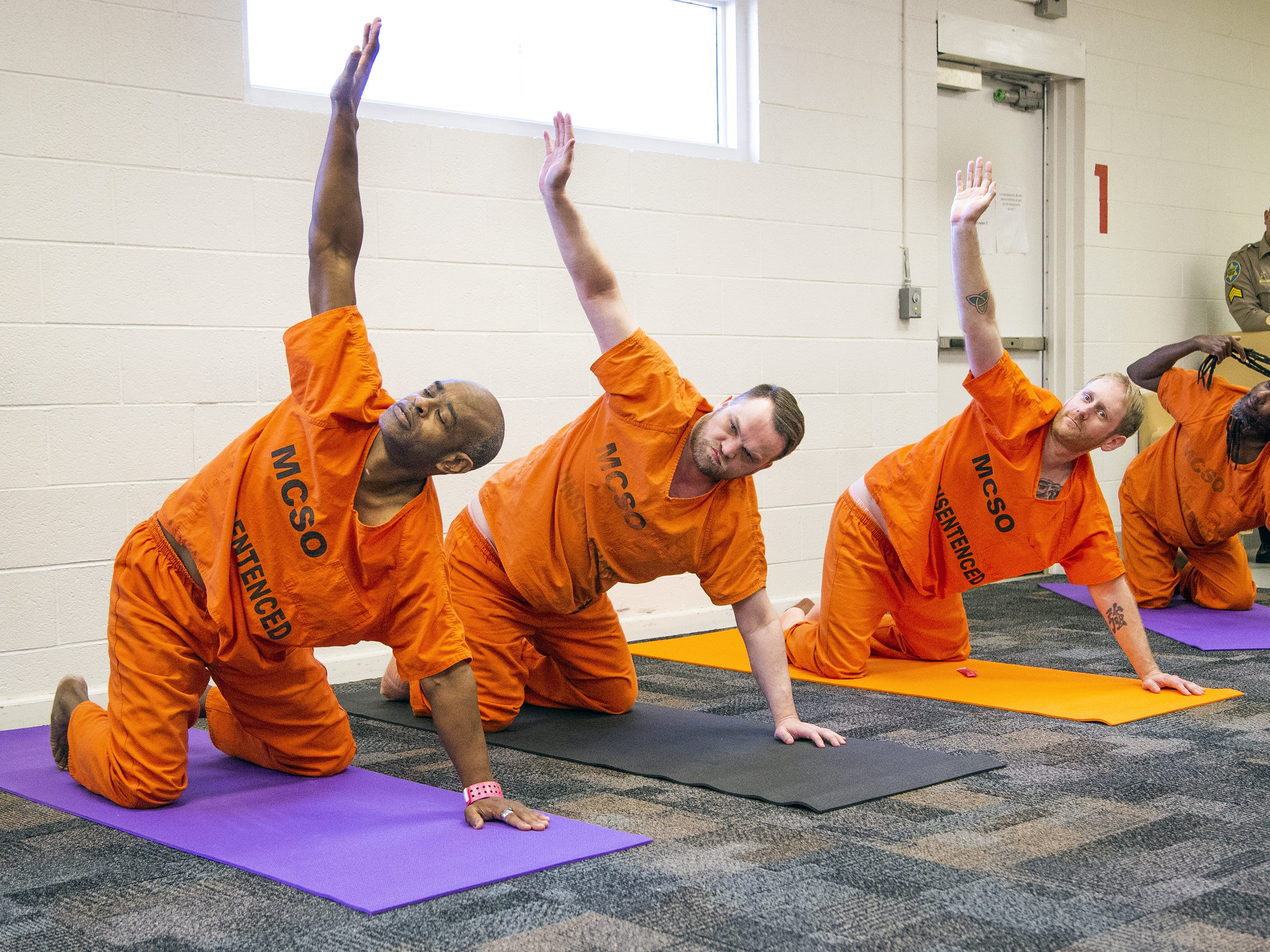 Inmates practice yoga during a class run by the Prison Yoga Project Phoenix at the Maricopa County Towers Jail complex on Jan. 11, 2019.