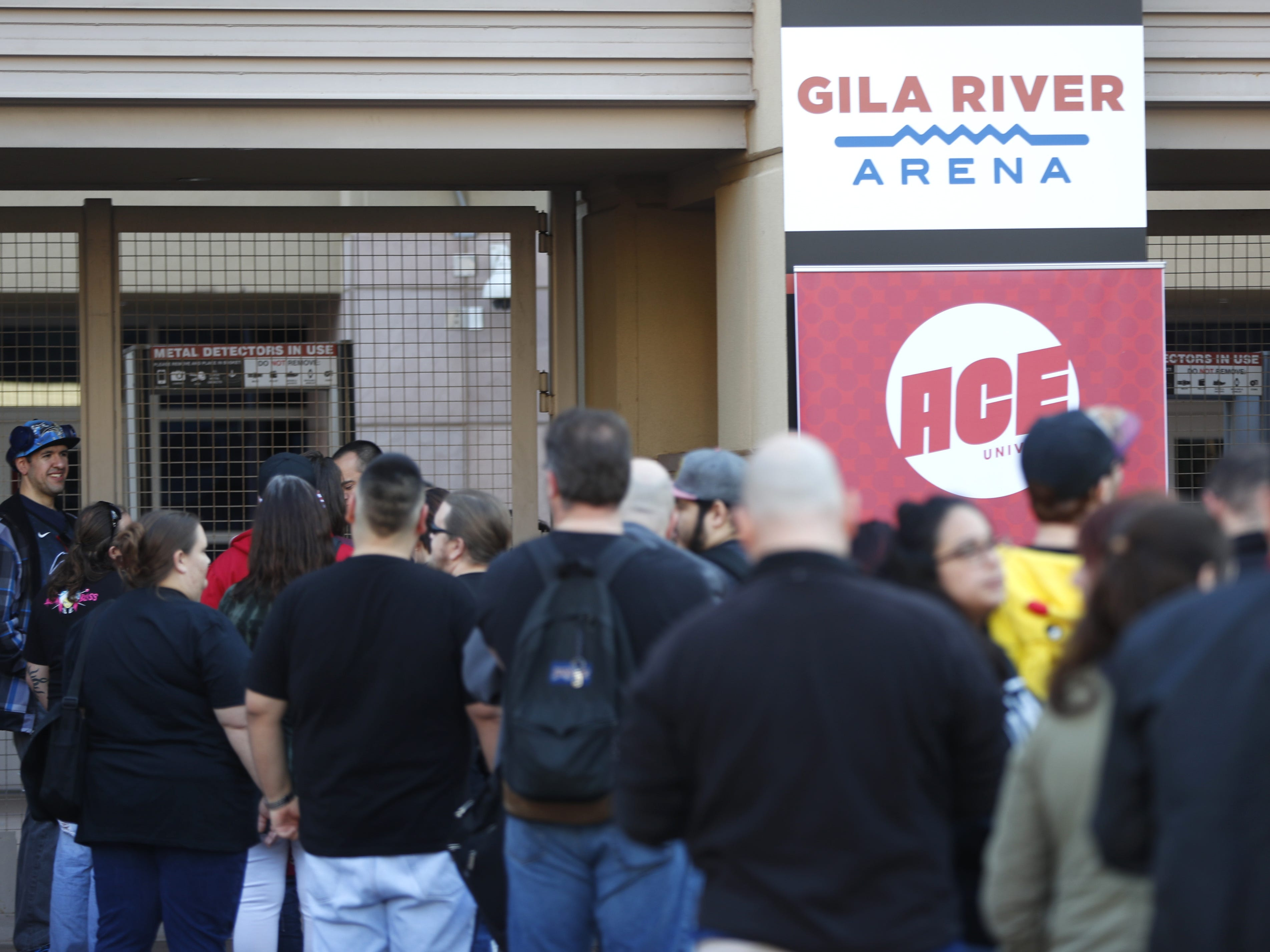 People arrive and wait for gates to open on the opening day of Ace Comic Con 2019 at Gila River Arena in Glendale, Ariz. on Jan. 11, 2019.