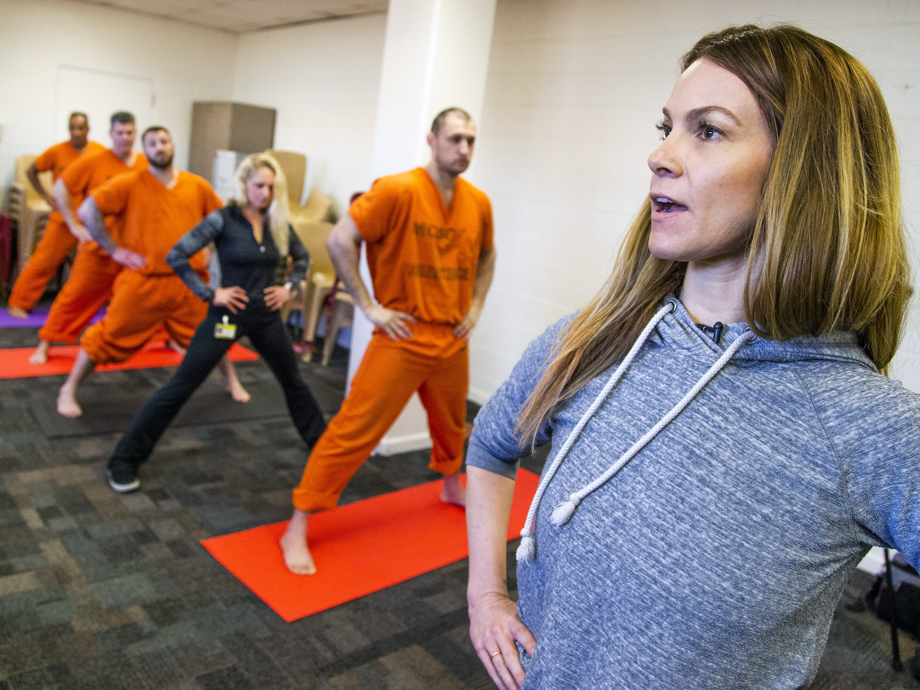 Volunteer Laura Walton helps run a yoga class offered by the Prison Yoga Project Phoenix at the Maricopa County Towers Jail complex on Jan. 11, 2019.