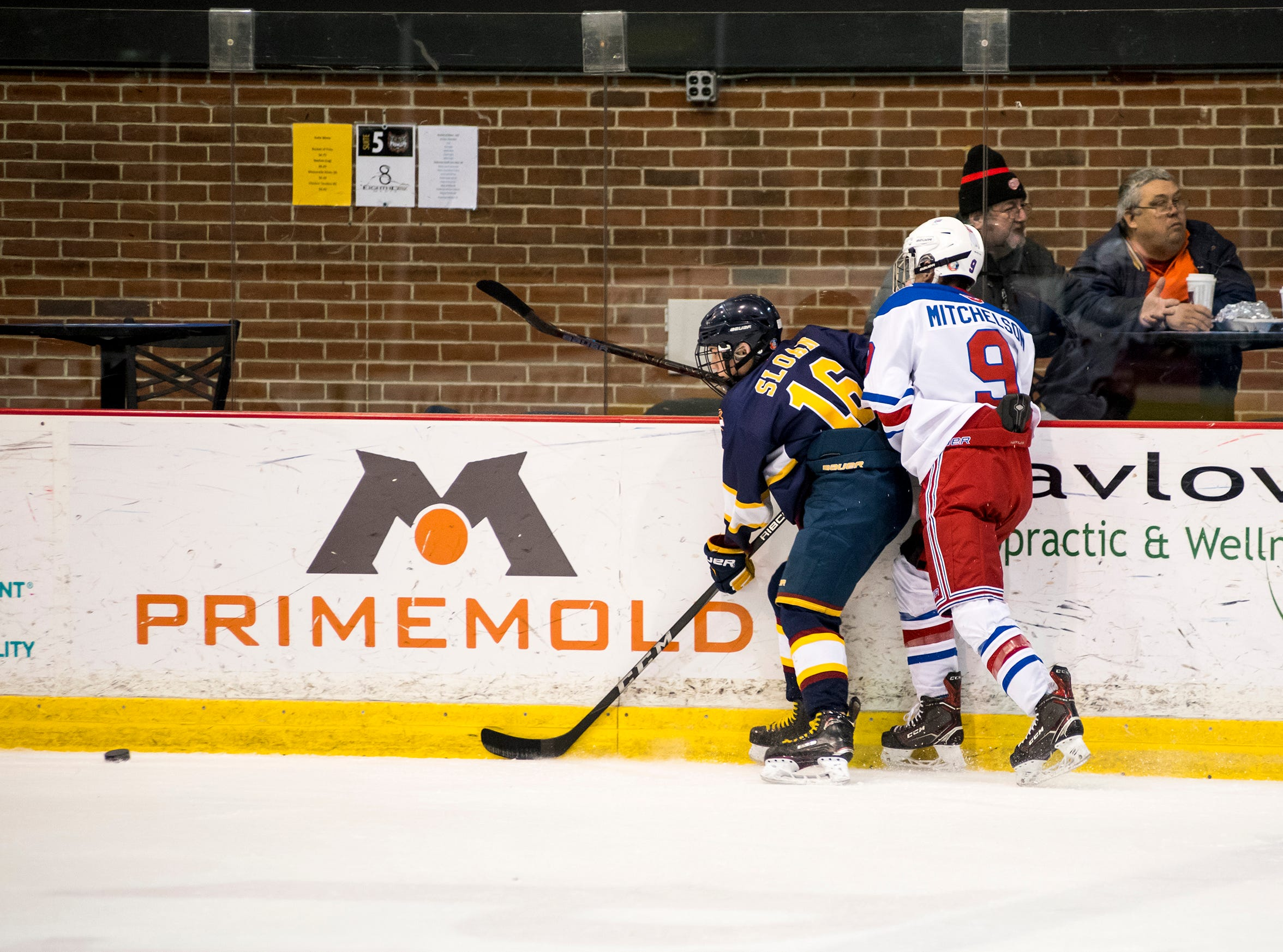 Burlington Eagles Gold forward Colin Sloan (16) holds Oakville Rangers forward Talon Mitchelson against the wall during their Silver Stick Finals BMA match Saturday, Jan. 12, 2019 at McMorran Arena.