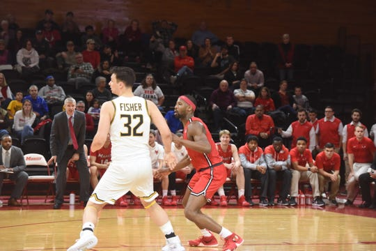 Marist's Isaiah Lamb guards Siena's Evan Fisher in the Saints' 71-66 win over the Red Foxes in Poughkeepsie on Friday.