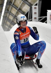 Summer Britcher of United States reacts after she placed third of a women's race at the Luge World Cup event in Sigulda, Latvia, Saturday, Jan. 12, 2019. (AP Photo/Roman Koksarov)