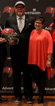 New Tampa Bay Buccaneers head coach Bruce Arians, center, and his wife, Chris, are shown after Bruce was introduced as the Bucs' new head coach on Thursday.