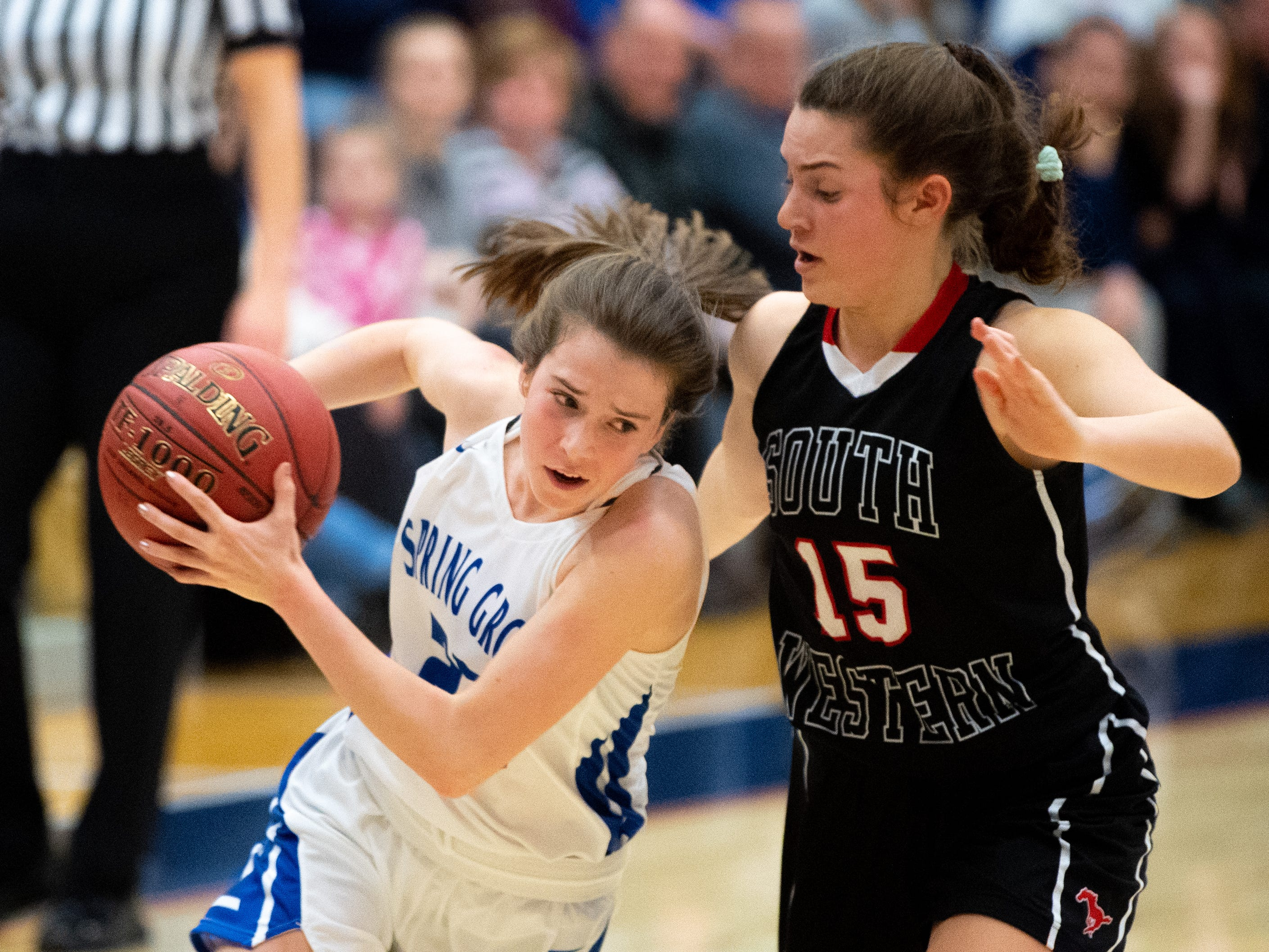 Ella Kale (22) of Spring Grove protects the ball during the girls' basketball game between Spring Grove and South Western, Friday, January 11, 2019. The Rockets defeated the Mustangs 51 to 38.