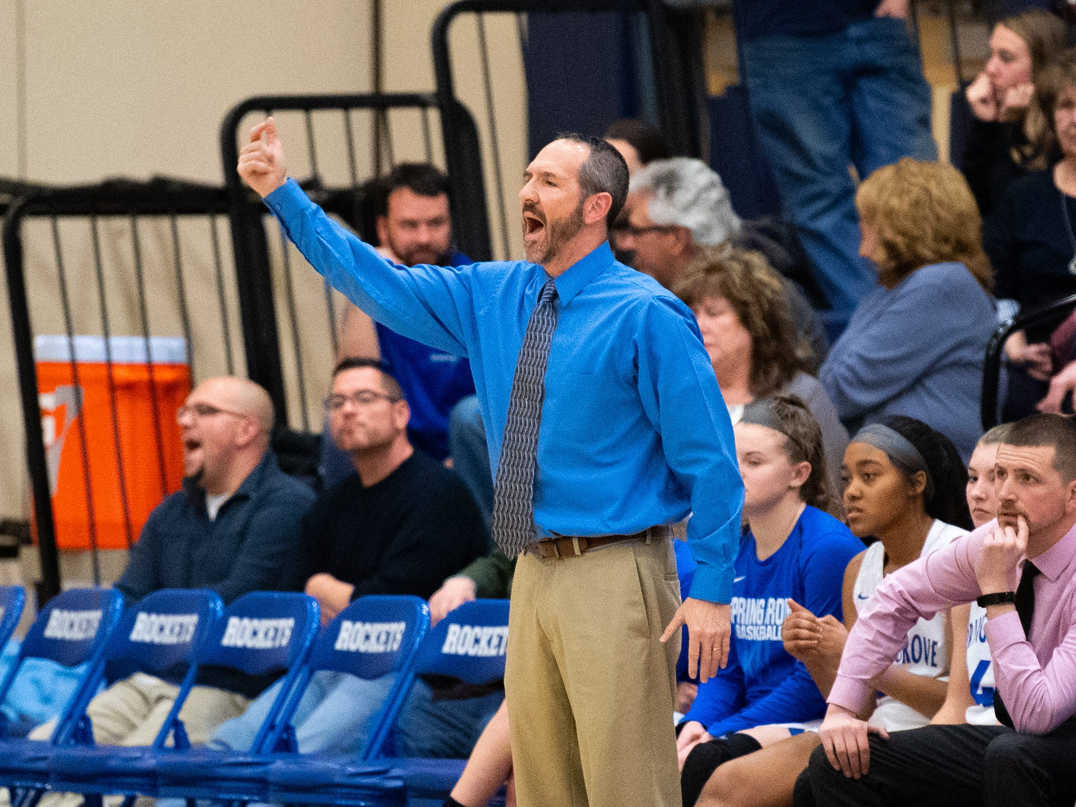 Spring Grove coach Troy Sowers instructs his team from the sidelines during the girls' basketball game between Spring Grove and South Western, Friday, January 11, 2019. The Rockets defeated the Mustangs 51 to 38.