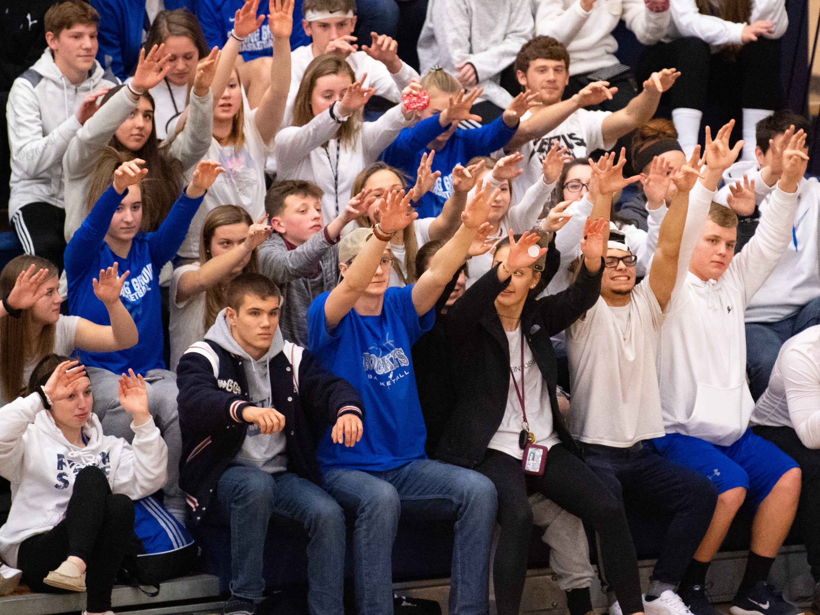 Spring Grove's student section cheers their team on during the girls' basketball game between Spring Grove and South Western, Friday, January 11, 2019. The Rockets defeated the Mustangs 51 to 38.