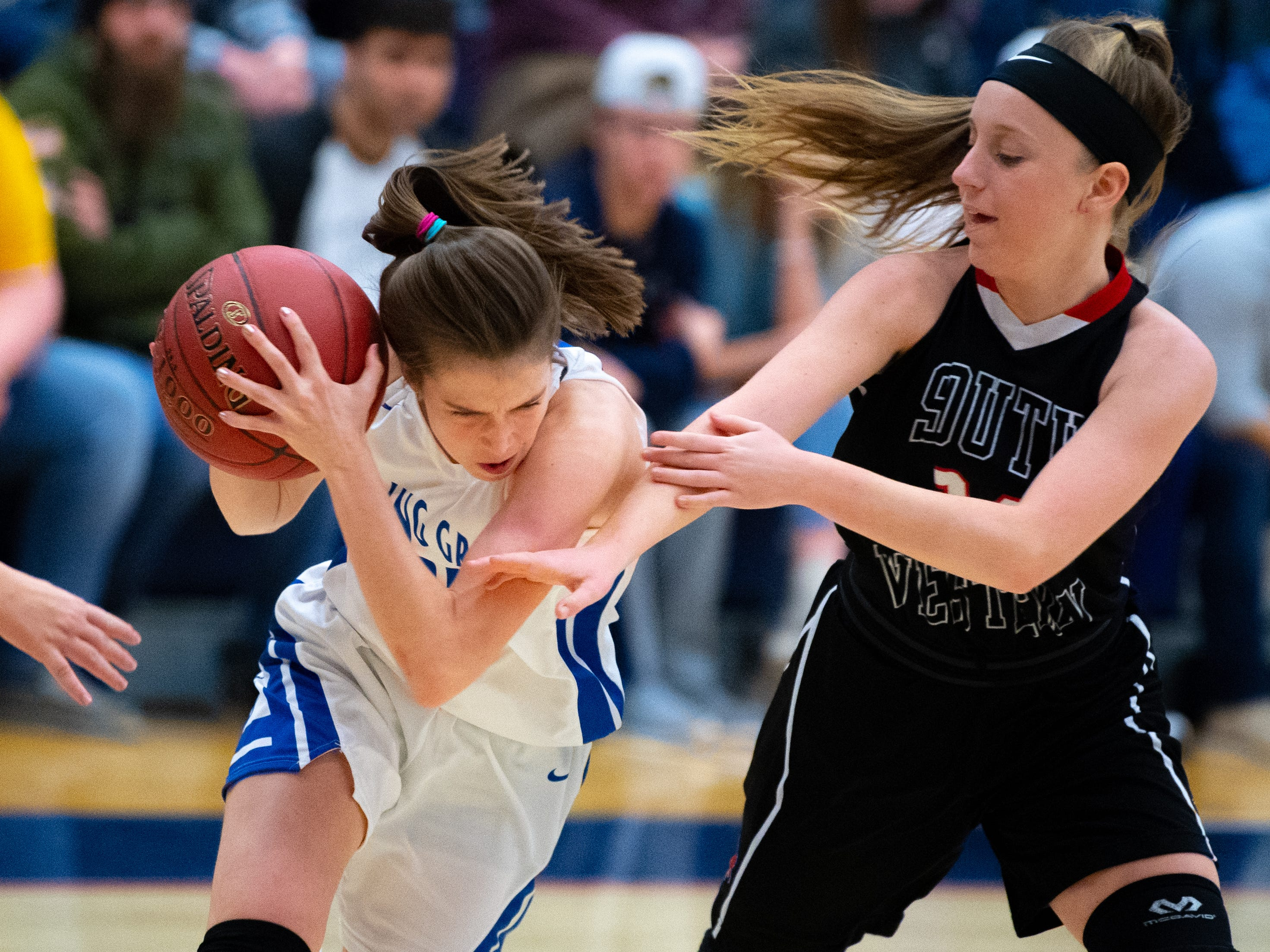 Ella Kale (22) of Spring Grove tries to get past South Western's Madi Wisensale (24) during the girls' basketball game, Friday, January 11, 2019. The Rockets defeated the Mustangs 51 to 38.