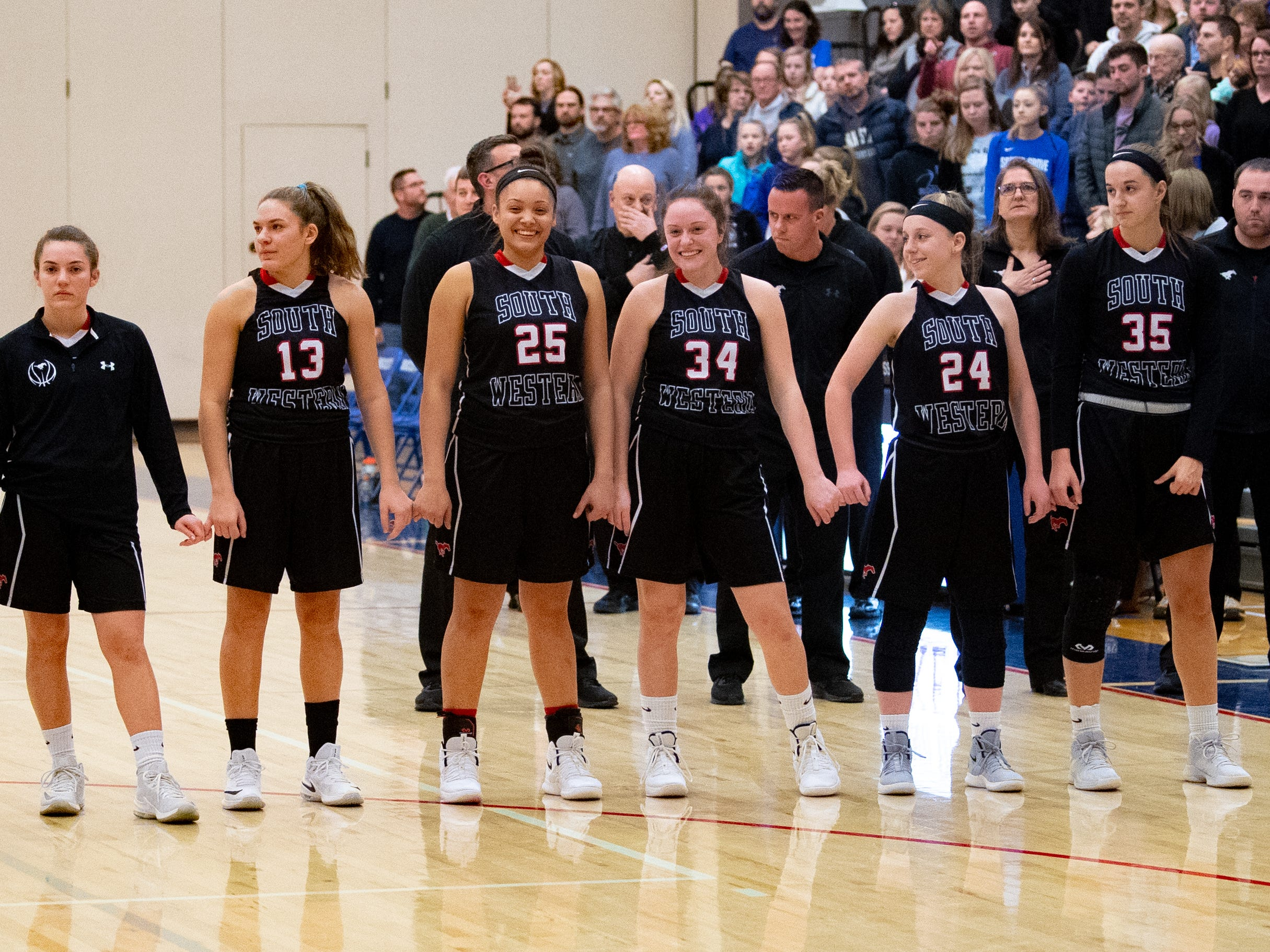 South Western prepares for the singing of the National Anthem during the girls' basketball game between Spring Grove and South Western at Spring Grove Area High School, Friday, January 11, 2019. The Rockets defeated the Mustangs 51 to 38.