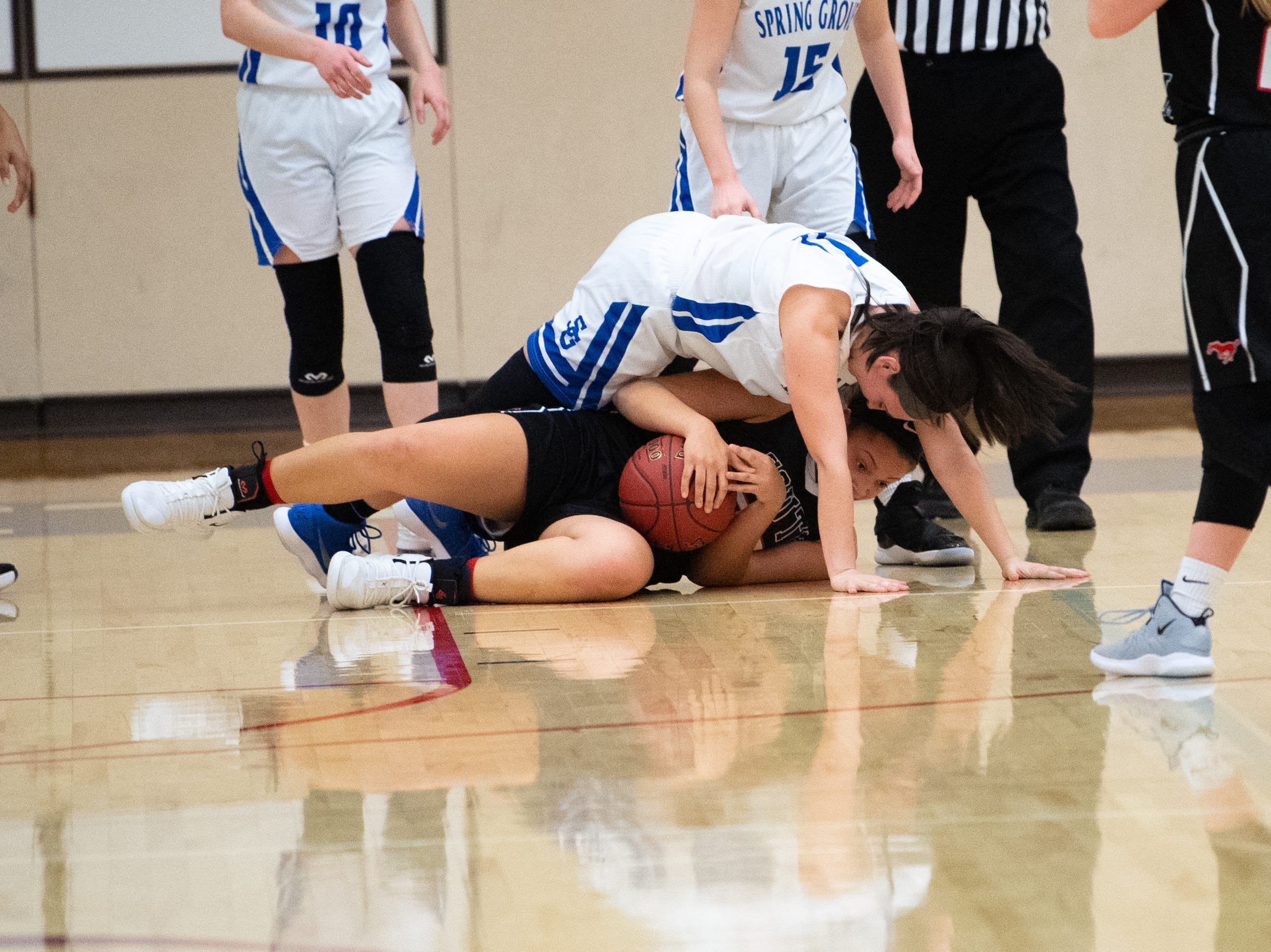 Ali St. Rose (25) of South Western secures the ball during the girls' basketball game between Spring Grove and South Western, Friday, January 11, 2019. The Rockets defeated the Mustangs 51 to 38.