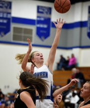 McQueen's Kendra McAninch shoots the ball against during a home game against Galena on Jan. 11.
