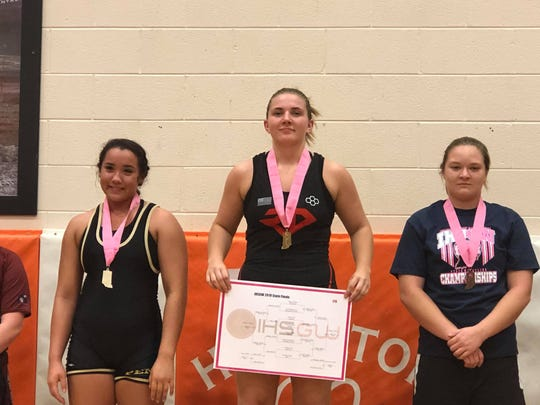 Jess Moore of Richmond (center) earned the 170-pount state championship at Friday's IHSWCA girls state finals.