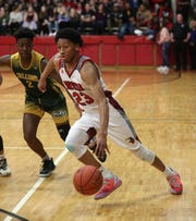Northstar's Miles Brown drives around Finney's Josh Taylor.