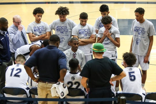 Gates Chili head coach Terry Nowden talks to the team during a first quarter timeout during a Section V high school boys basketball game against the Webster Thomas Titans at Gates Chili High School on Jan. 11, 2019.