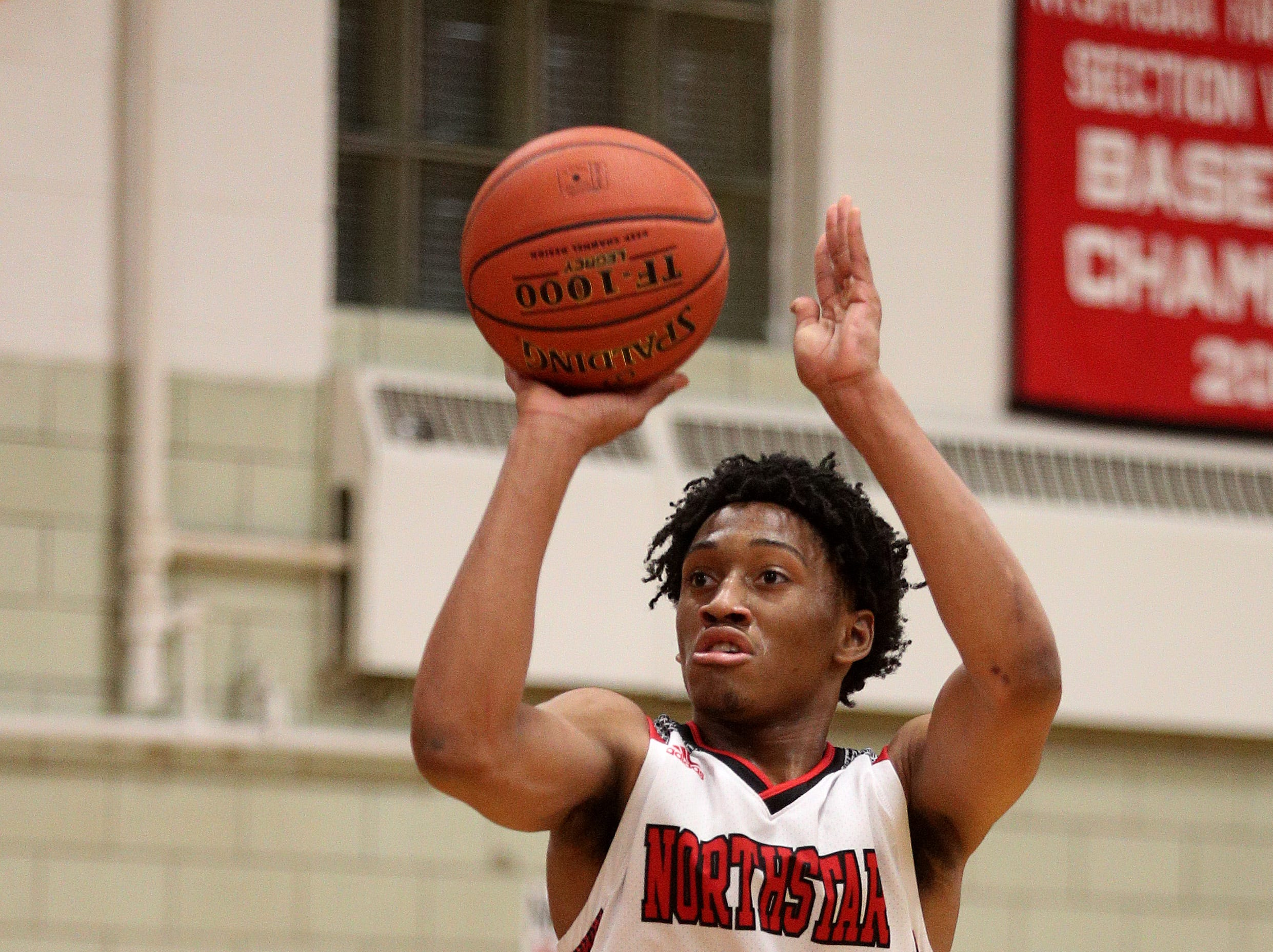 Northstar's Miles Brown pulls up to take a jump shot against Finney.